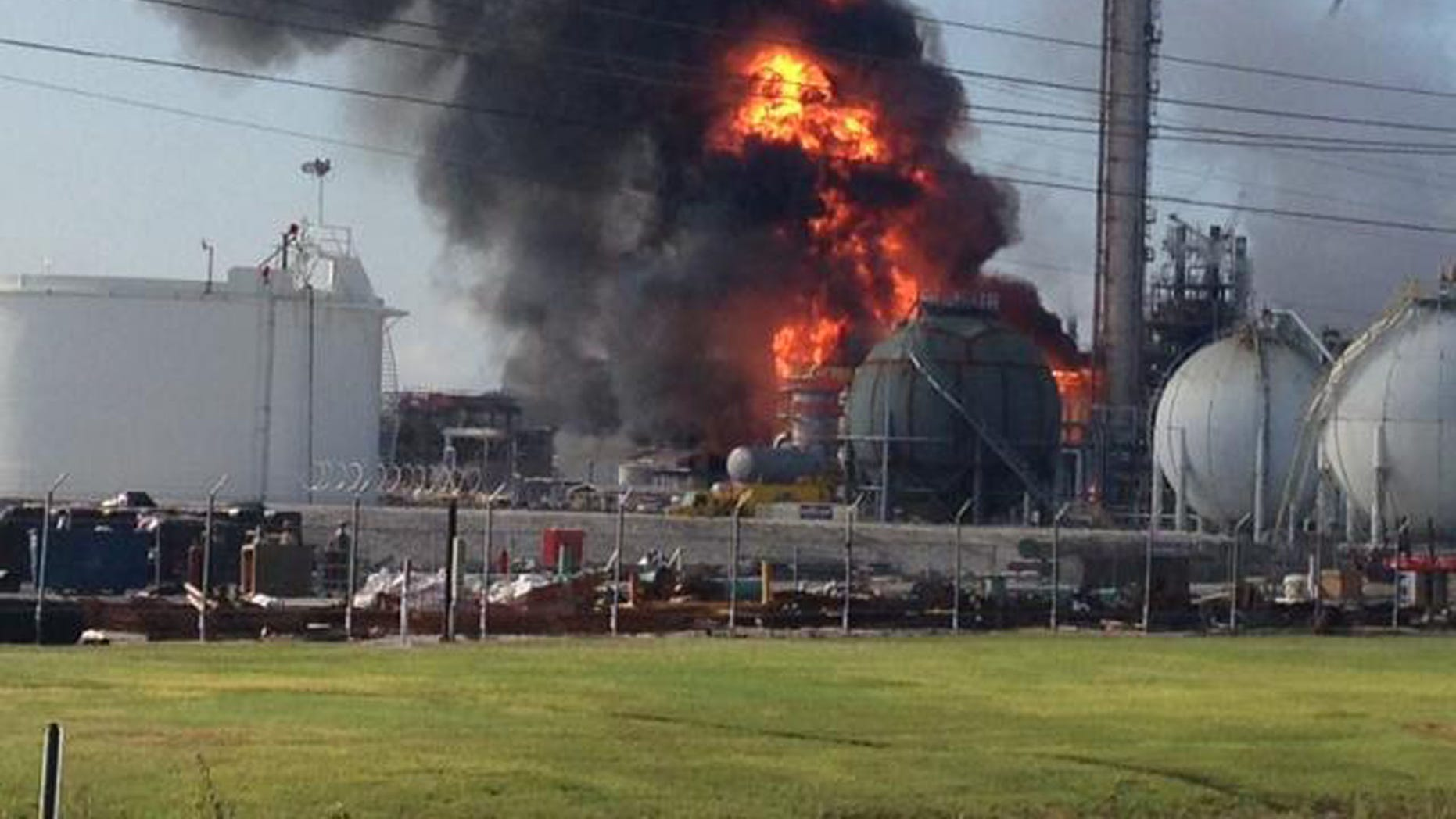 June 13, 2013: This photo provided by Ryan Meador shows an explosion at The Williams Companies Inc. plant in the Ascension Parish town of Geismar La.