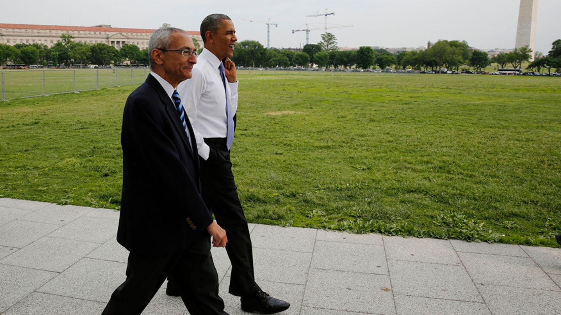 U.S. President Barack Obama walks on the Ellipse with White House counselor John Podesta near the White House in Washington May 21, 2014.