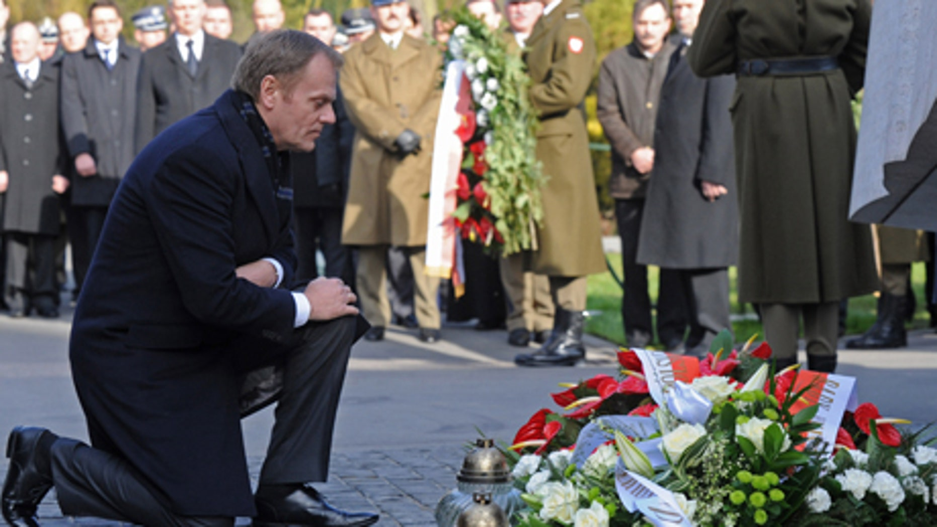 Tuesday April 10:Polish Prime Minister Donald Tusk kneels in front of a memorial dedicated to the victims of a presidential plane crash during commemorations marking the second anniversary of the accident, at the Powazki cemetery in Warsaw, Poland. Exactly two years ago a plane with Polish President Lech Kaczynski, his wife and officials crashed in Russia, killing all on board.