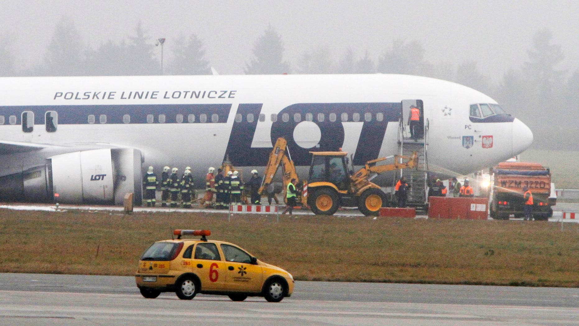 Nov. 2, 2011: Staff of the Frederic Chopin airport in Warsaw, Poland, prepare to move a Boeing 767 of Polish LOT airlines to unblock one of the airport's two runways and allow for air traffic.