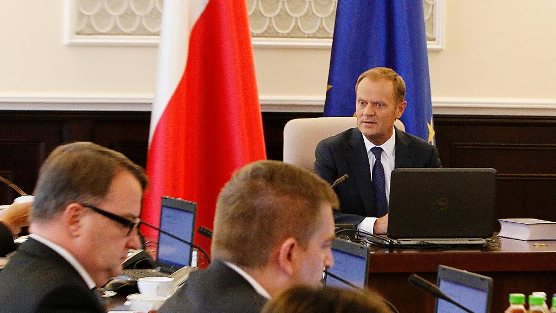 Poland's Prime Minister Donald Tusk, right, attends his last meeting of the Council of Ministers in Warsaw, Poland, Tuesday, Sept. 9, 2014. The government is resigning because Tusk was recently chosen to be the next head of the European Commission. (AP Photo/Czarek Sokolowski)