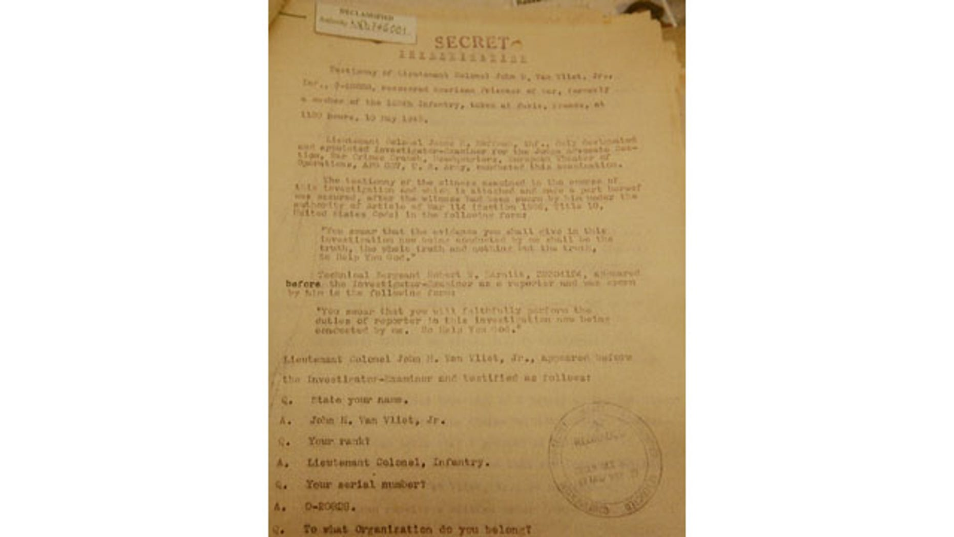 January 8, 2014: This picture shows a copy of the first page of what is believed recently uncovered vital testimony made in 1945 in Paris by U.S. Lt. Col. John H. Van Vliet Jr. It provides evidence of Soviet responsibility for the World War II massacre of some 22,000 Polish officers in Katyn forest and other locations in then-Soviet Union. (AP)