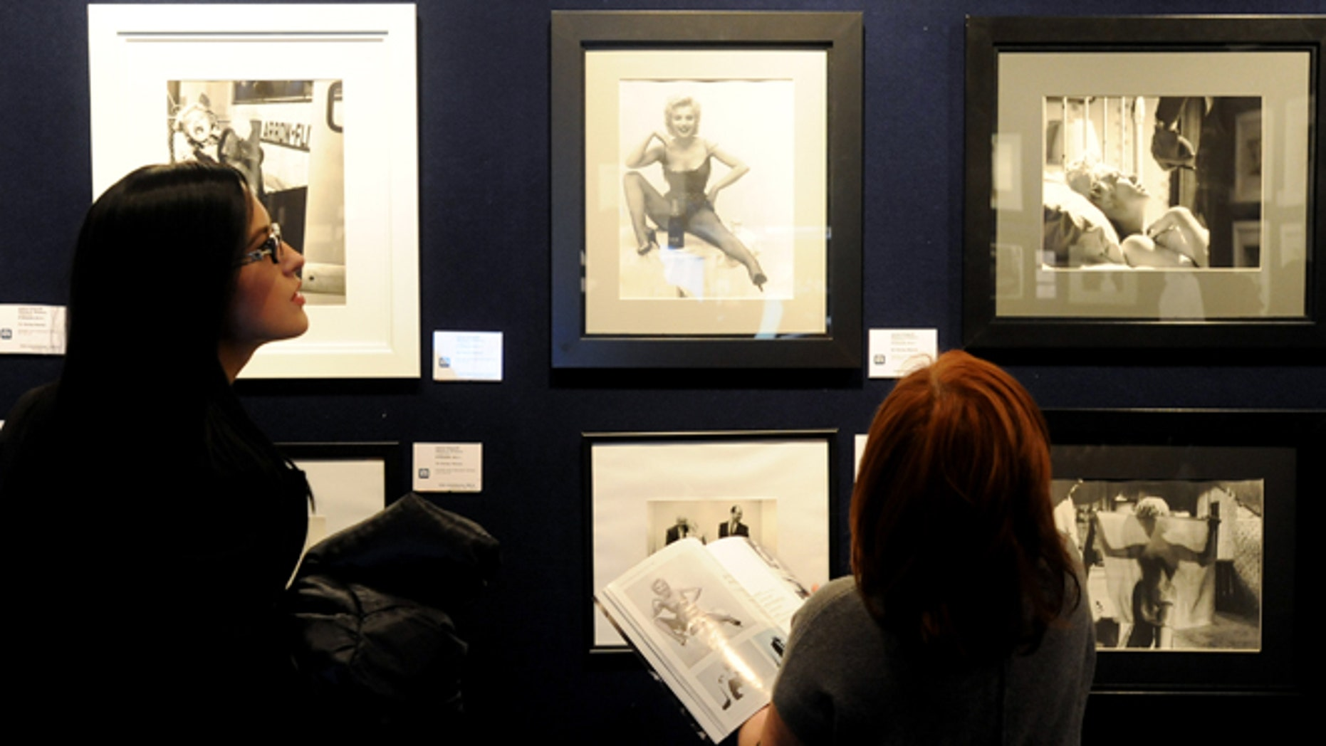Nov. 8, 2012: Potential bidders look at Marylin Monroe photos prior to an auction of pictures by the late celebrity photographer Milton H. Greene, in Warsaw, Poland.