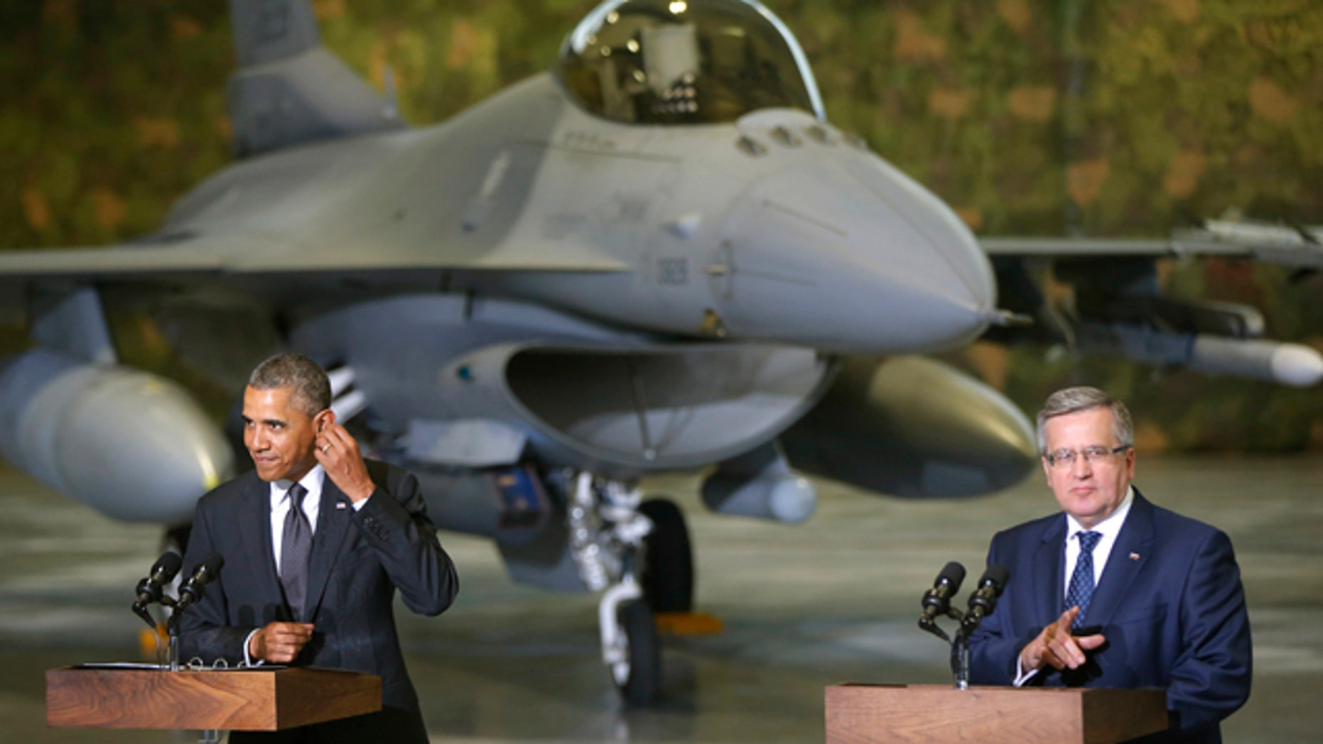 June 3, 2014: U.S. President Barack Obama and Poland's President Bronislaw Komorowski make statements and meet with U.S. and Polish troops at an event featuring four F-16 fighter jets, two American and two Polish, as part of multinational military exercises, in Warsaw. (AP Photo/Charles Dharapak)