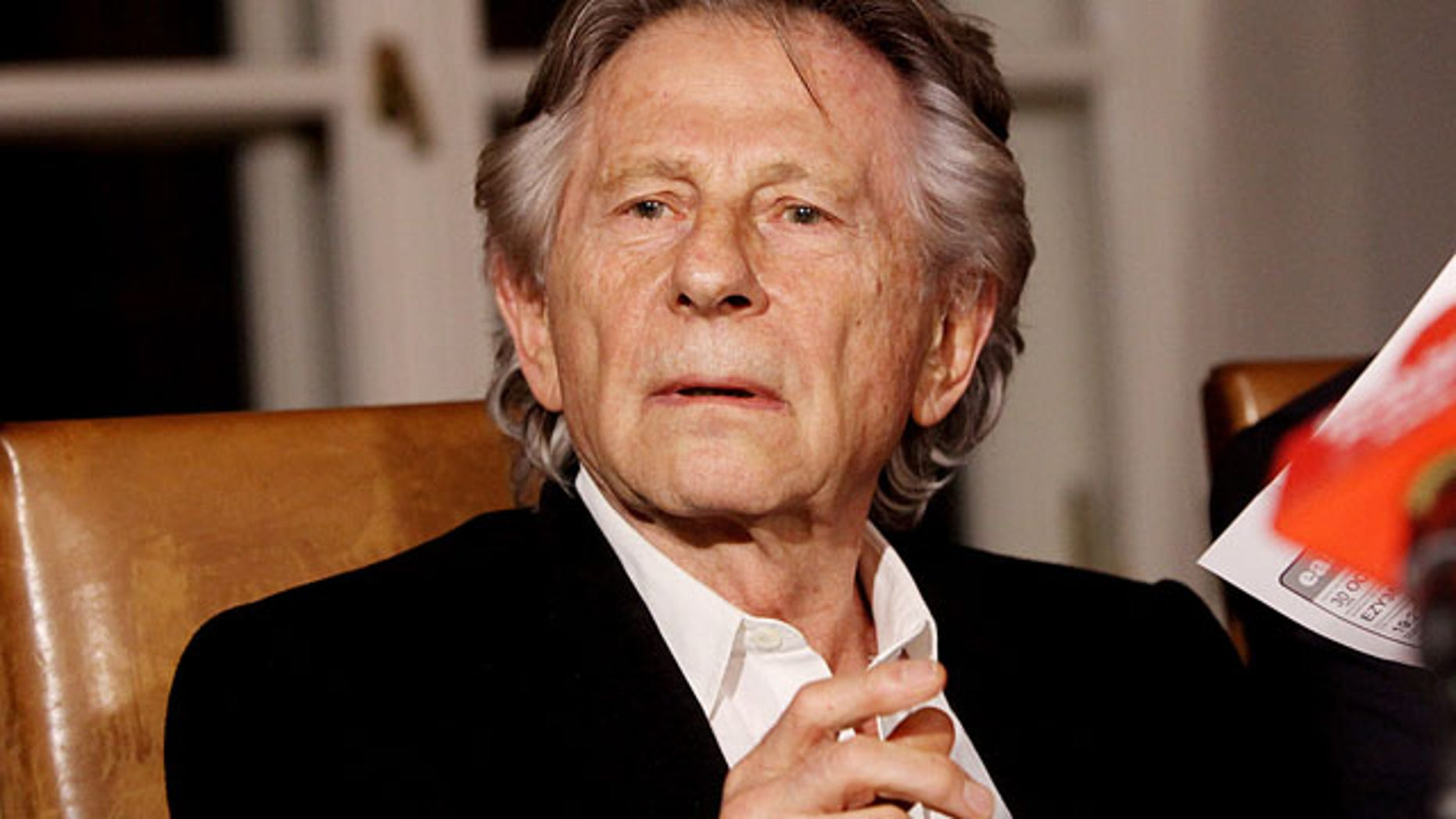 FILE - In this Oct. 30, 2015 file photo filmmaker Roman Polanski tells reporters he can breath with relief after a Polish judge ruled that the law forbids his extradition to the U.S., where in 1977 he pleaded guilty to having sex with a minor. (AP Photo/Jarek Praszkiewicz, file)