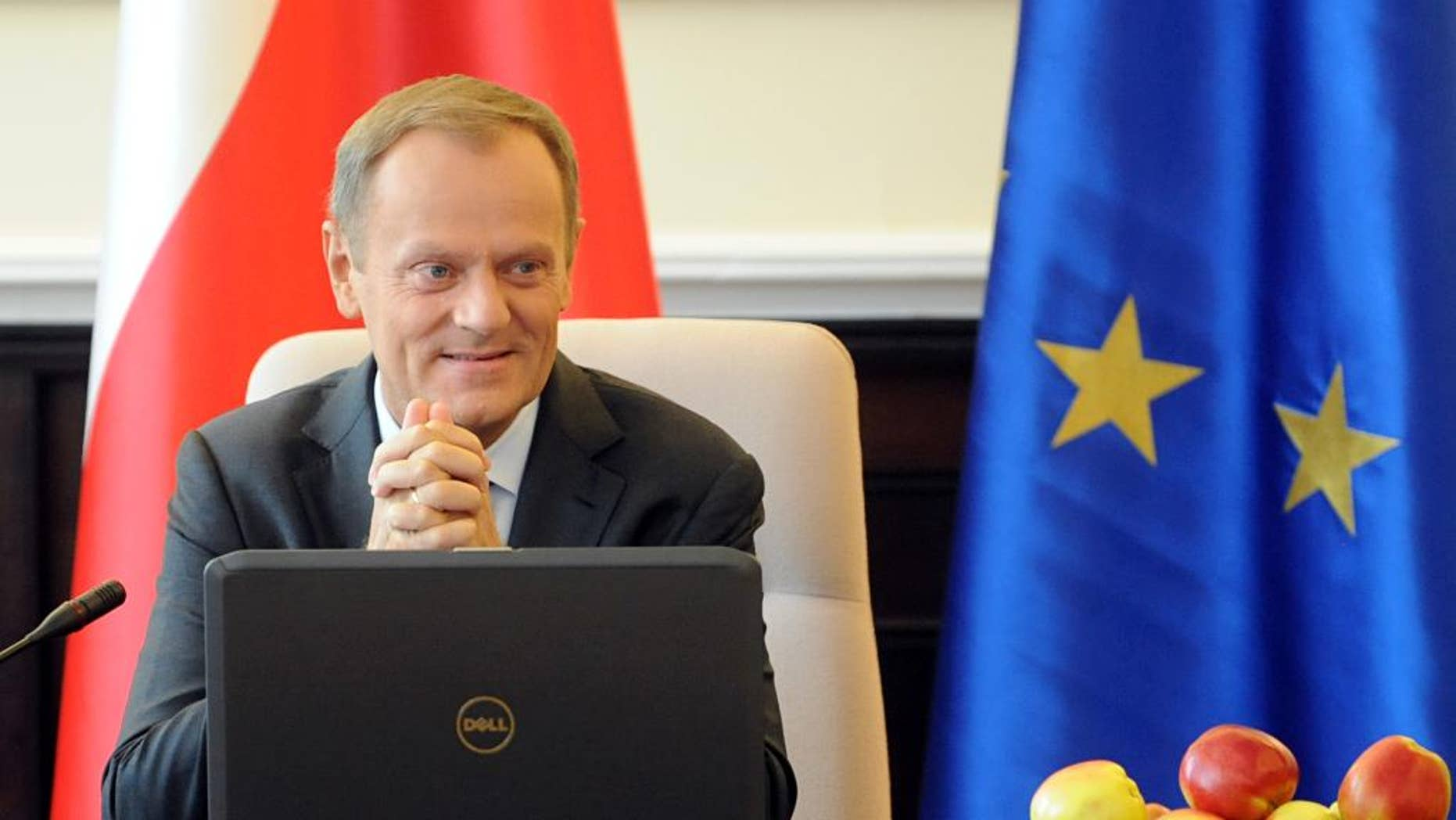 Polish Prime Minister Donald Tusk  opens a government meeting in Warsaw, Poland, Tuesday, Sept. 2, 2014. Tusk was chosen by EU leaders  to be the next president of the European Council.   (AP Photo/Alik Keplicz)