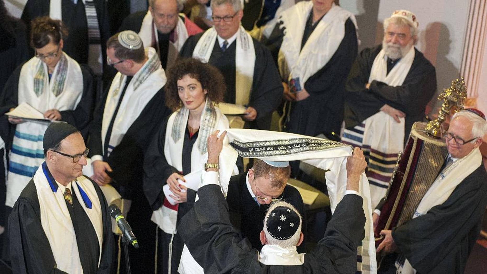 President of the Abraham Geiger College Rabbi Prof. Walter Jacob, front center, presides during the Rabbi ordination at the White Stork synagogue in Wroclaw, Poland,Tuesday, Sept. 2 2014. The ordination of four rabbis and three cantors, graduates of Abraham Geiger College at the Potsdam University, in Wroclaw, commemorates the 140th anniversary of the death of Rabbi Abraham Geiger, who held his office during 1838-1863 in the White Stork Synagogue. (AP Photo)