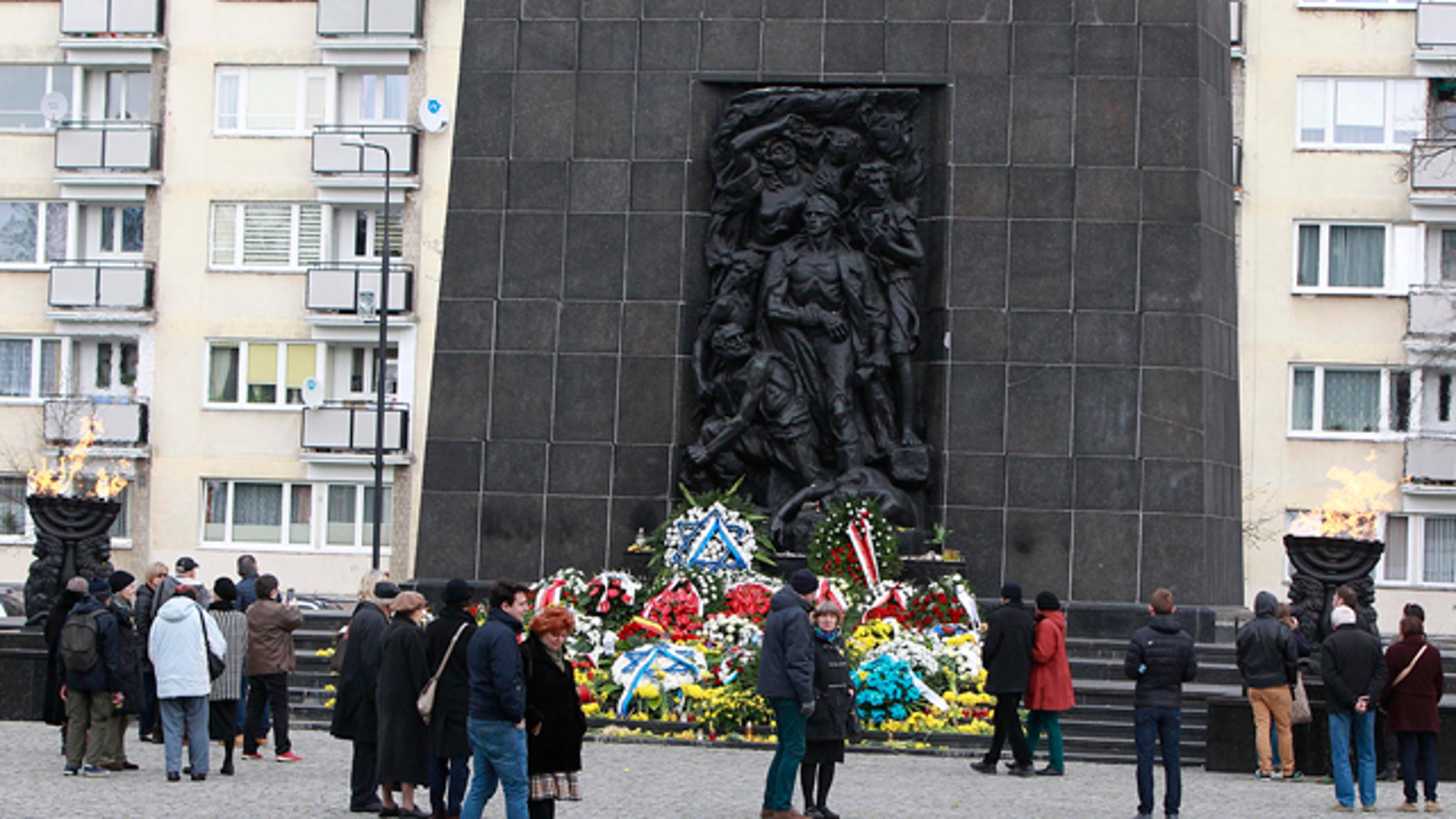 April 19, 2015: People gather in front of the monument to the Heroes of the Ghetto, on the 72nd anniversary of the Warsaw Ghetto Uprising, in Warsaw. (AP Photo/Czarek Sokolowski)