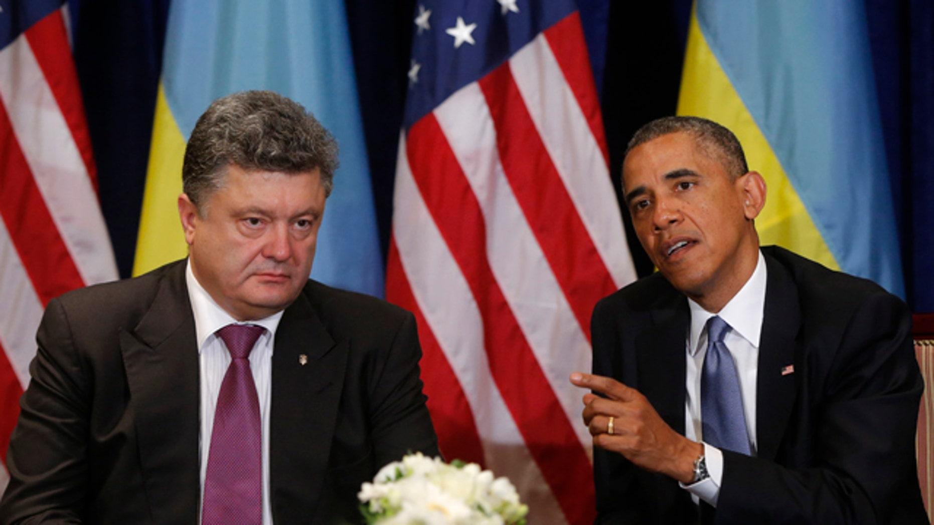 June 4, 2014: U.S. President Barack Obama, right, meets with Ukraine president-elect Petro Poroshenko in Warsaw, Poland. (AP Photo/Charles Dharapak)