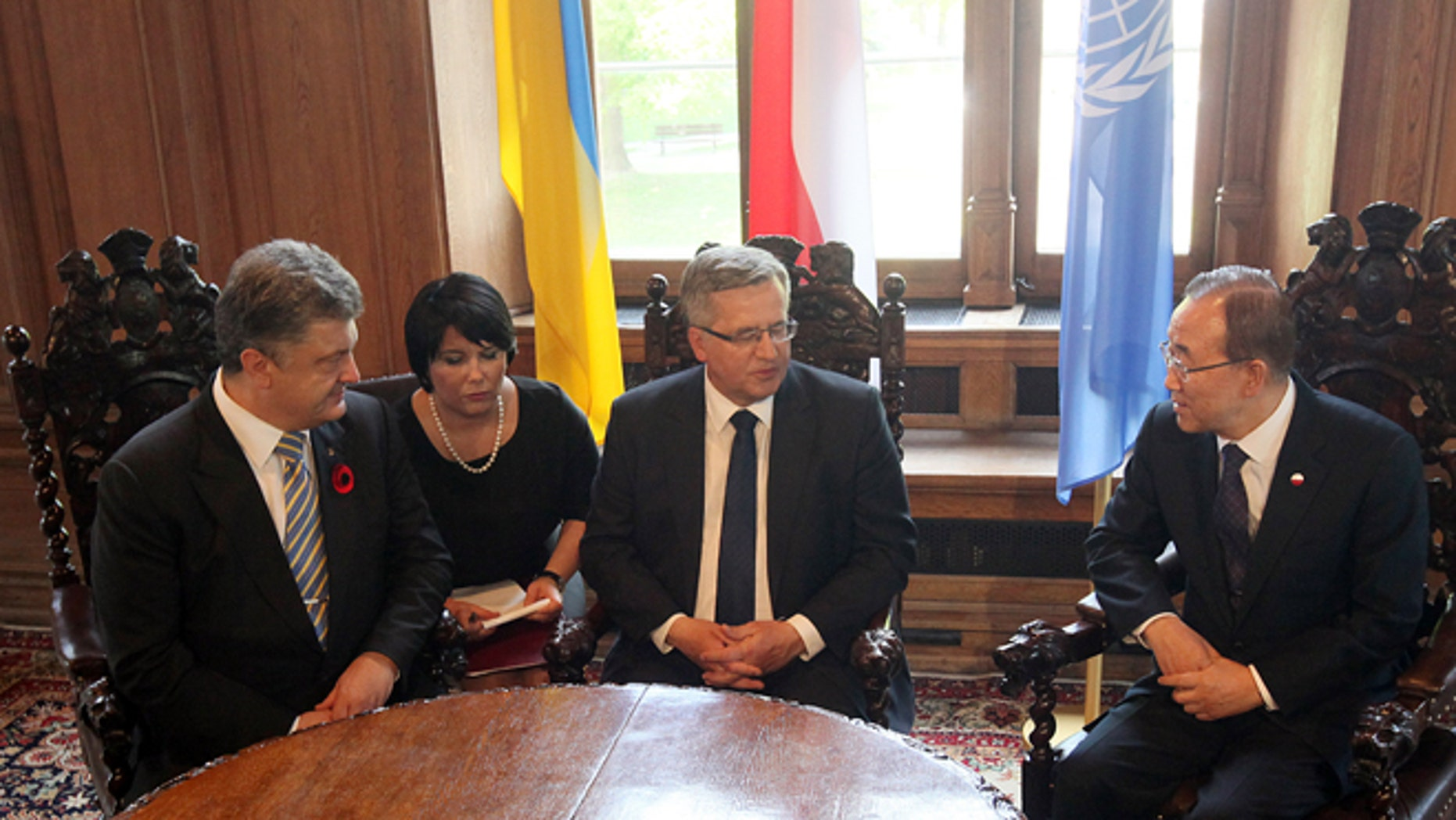 May 7, 2015: Poland's President Bronislaw Komorowski, center, meets U.N. Secretary General Ban Ki-moon, right, and Ukraines President, Petro Poroshenko, left, at the City Hall in Gdansk, Poland, shortly before ceremonies he organized to mark 70 years of the end of World War II that began with Nazi Germanys attack on Poland in 1939.