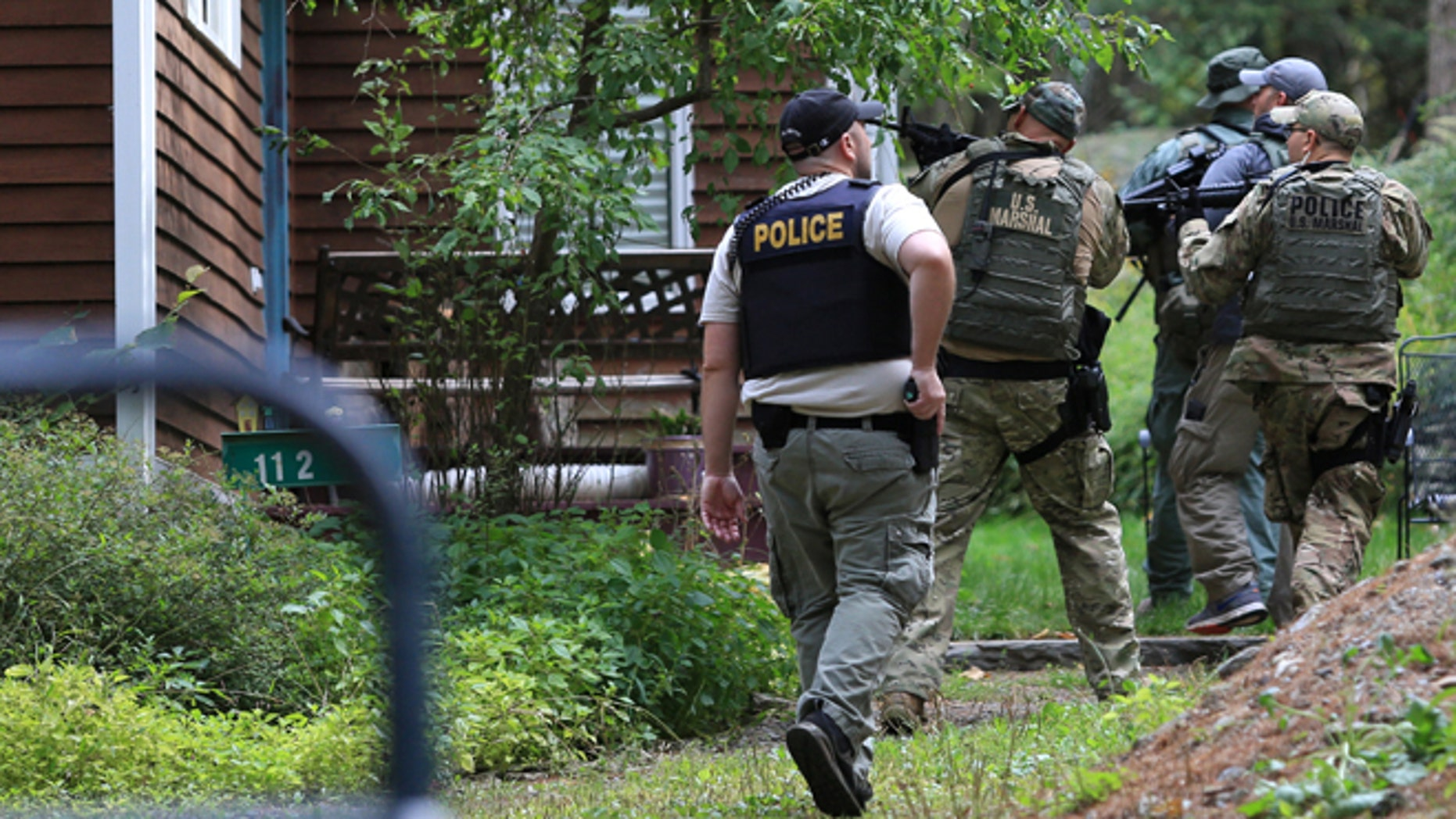 Sept. 24, 2014: Pennsylvania State Police troopers and U.S. Marshals investigate and clear homes in the search for suspect Eric Frein in Canadensis, Pa.  (AP/The Times-Tribune, Jake Danna Stevens)