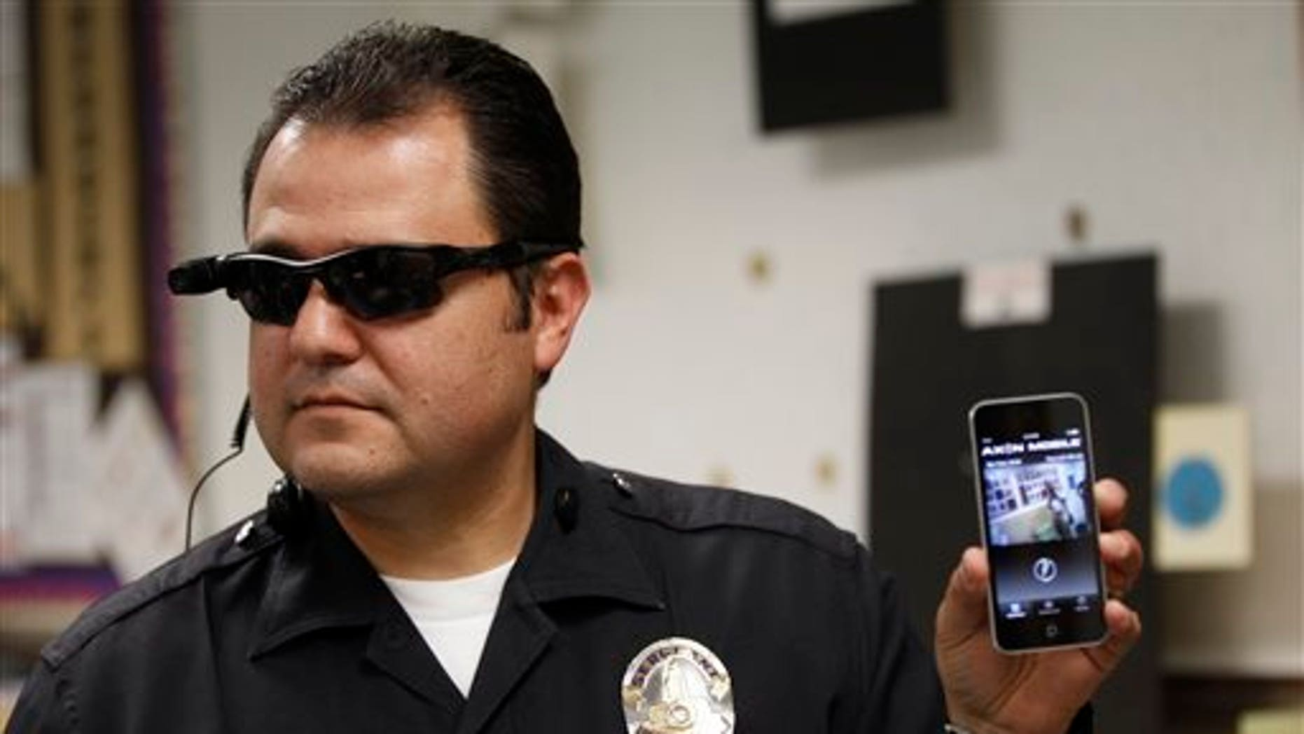 This Jan. 15, 2014 file photo shows Los Angeles Police Sgt. Daniel Gomez demonstrating a video feed from his camera into his cellphone as on-body cameras are demonstrated for the media in Los Angeles. Thousands of police agencies have equipped officers with cameras to wear with their uniforms, but theyve frequently lagged in setting policies on how theyre used, potentially putting privacy at risk and increasing their liability. As officers in one of every six departments across the nation now patrols with tiny lenses on their chests, lapels or sunglasses, administrators and civil liberties experts are trying to envision and address troublesome scenarios that could unfold in front of a live camera. (AP Photo/Damian Dovarganes)