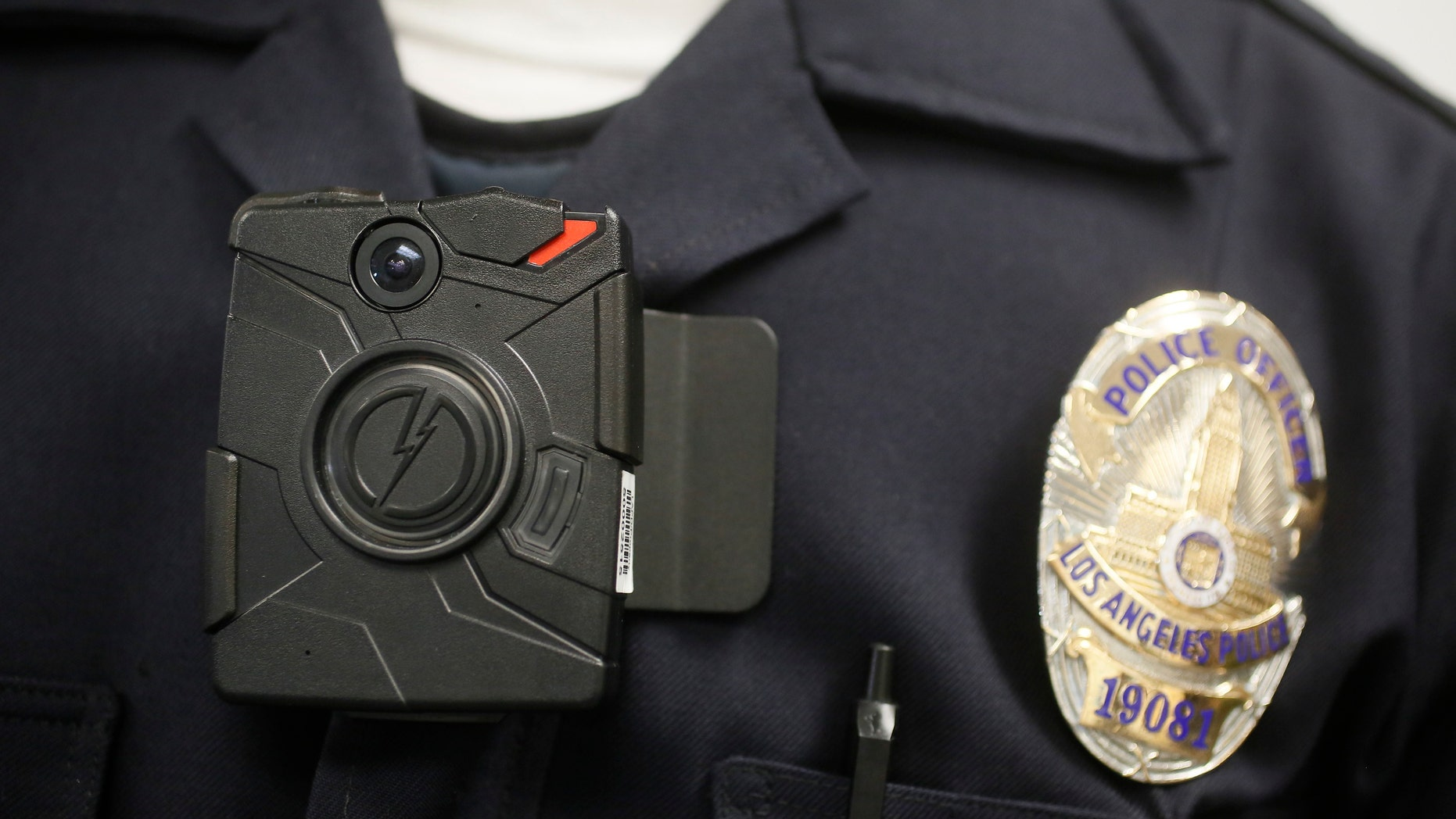 Jan. 15, 2014: This file photo shows a Los Angeles Police officer wearing an on-body cameras during a demonstration for media in Los Angeles.