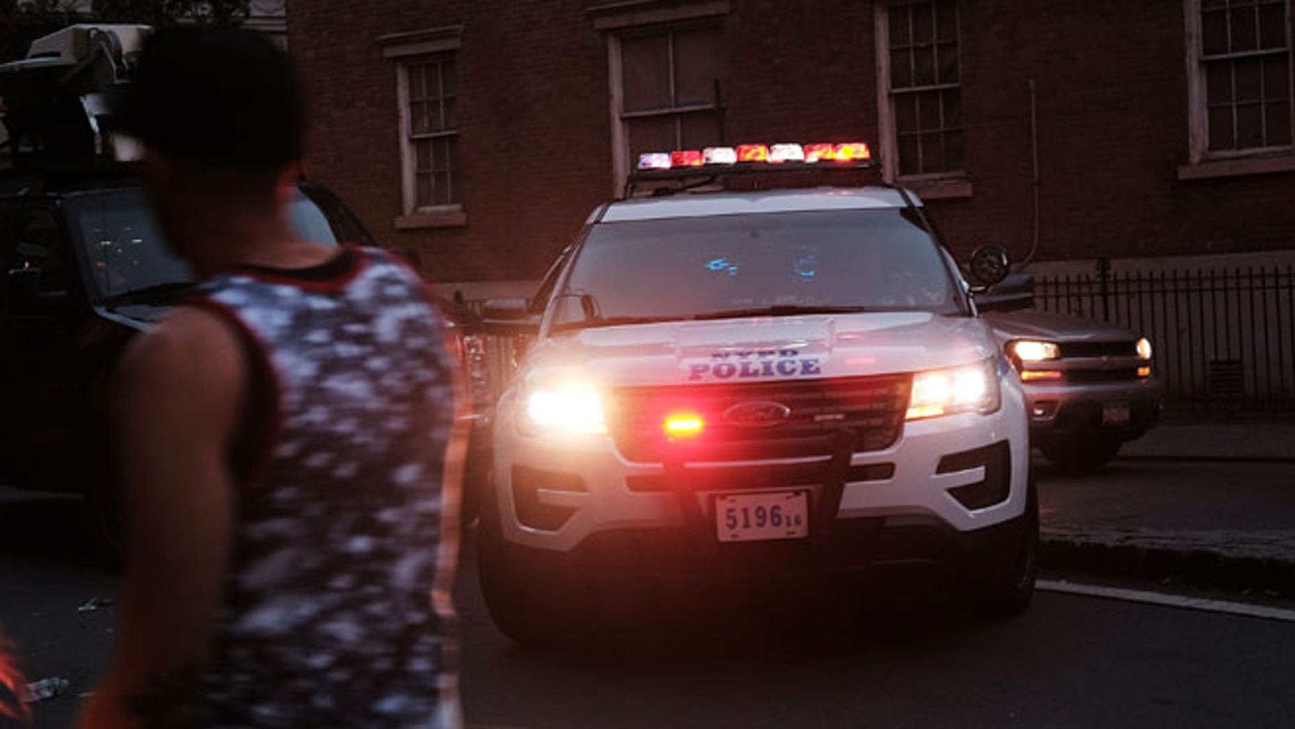 NEW YORK, NY - JUNE 12:  A heavy police presence gathers near the iconic New York City gay and lesbian bar The Stonewall Inn to following the mass killings in Orlando last evening on June 12, 2016 in New York City. An American-born man who'd recently pledged allegiance to ISIS killed 50 people early Sunday at a gay nightclub in Orlando, Florida. The massacre was the deadliest mass shooting in the United States.  (Photo by Spencer Platt/Getty Images)