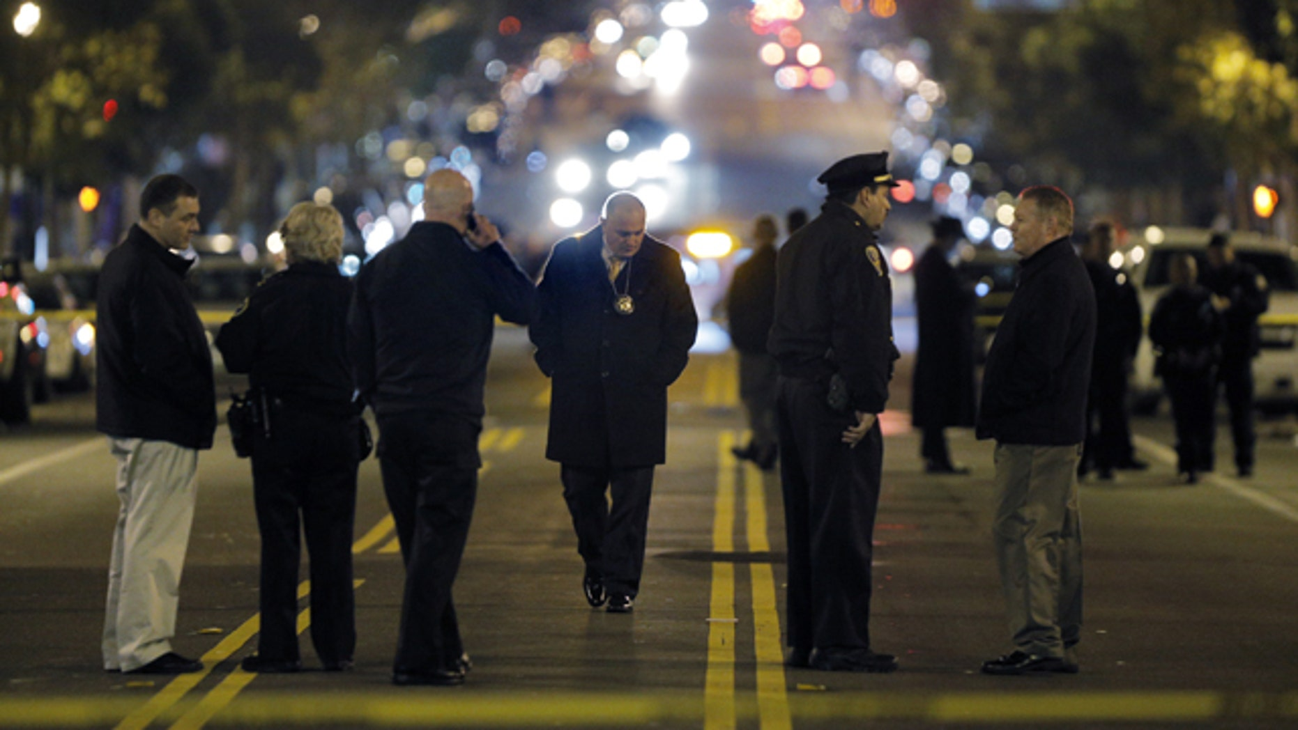 Jan: 4, 2015: Police investigators search for evidence after an officer-involved shooting at the San Francisco Police Mission Station in San Francisco. Officers shot and killed a man who brandished what appeared to be a handgun but was actually an air gun after they told him to leave a restricted parking lot. (AP Photo/San Francisco Chronicle, Carlos Avila Gonzalez)