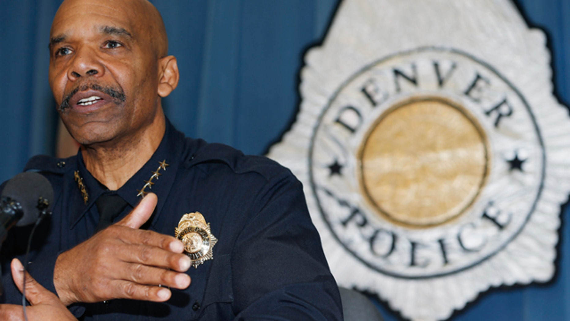 Jan. 29, 2015: Denver Police Department Chief Robert White responds to questions during a news conference about the death of a 17-year-old woman who was killed after she allegedly hit and injured a Denver Police Department officer while driving a stolen vehicle early Monday in a northeast Denver alley. (AP Photo/David Zalubowski)