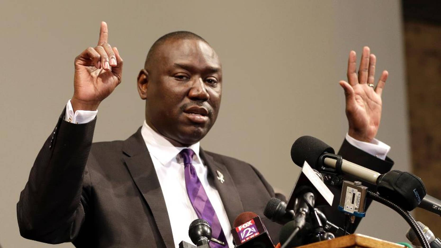 "FILE - In this Monday, Aug. 18, 2014, file photo, Brown family attorney Benjamin Crump speaks during a news conference in St. Louis County, Mo. Legal experts say a cellphone video that shows a witness raising his hands in the air immediately after the fatal shooting of Michael Brown in Ferguson appears to support previous accounts and could bolster arguments that Brown was surrendering when he was shot. Crump said the video is ""the best evidence you can have other than a video of the actual shooting itself."" (AP Photo/Jeff Roberson, File)"