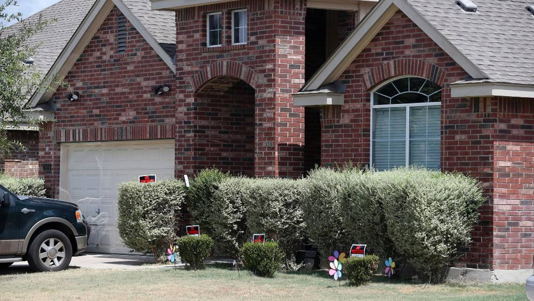 """No trespassing signs are visible at the house Tuesday, Sept. 1, 2015, where deputies fatally shot Gilbert Flores, in Northwest Bexar County, Texas, near San Antonio, last Friday. A Texas prosecutor says a second video has emerged that gives authorities a """"very clear view"""" of a confrontation between deputies and Flores who had his hands raised before he was shot and killed. (John Davenport/The San Antonio Express-News via AP) RUMBO DE SAN ANTONIO OUT; NO SALES; MANDATORY CREDIT"""