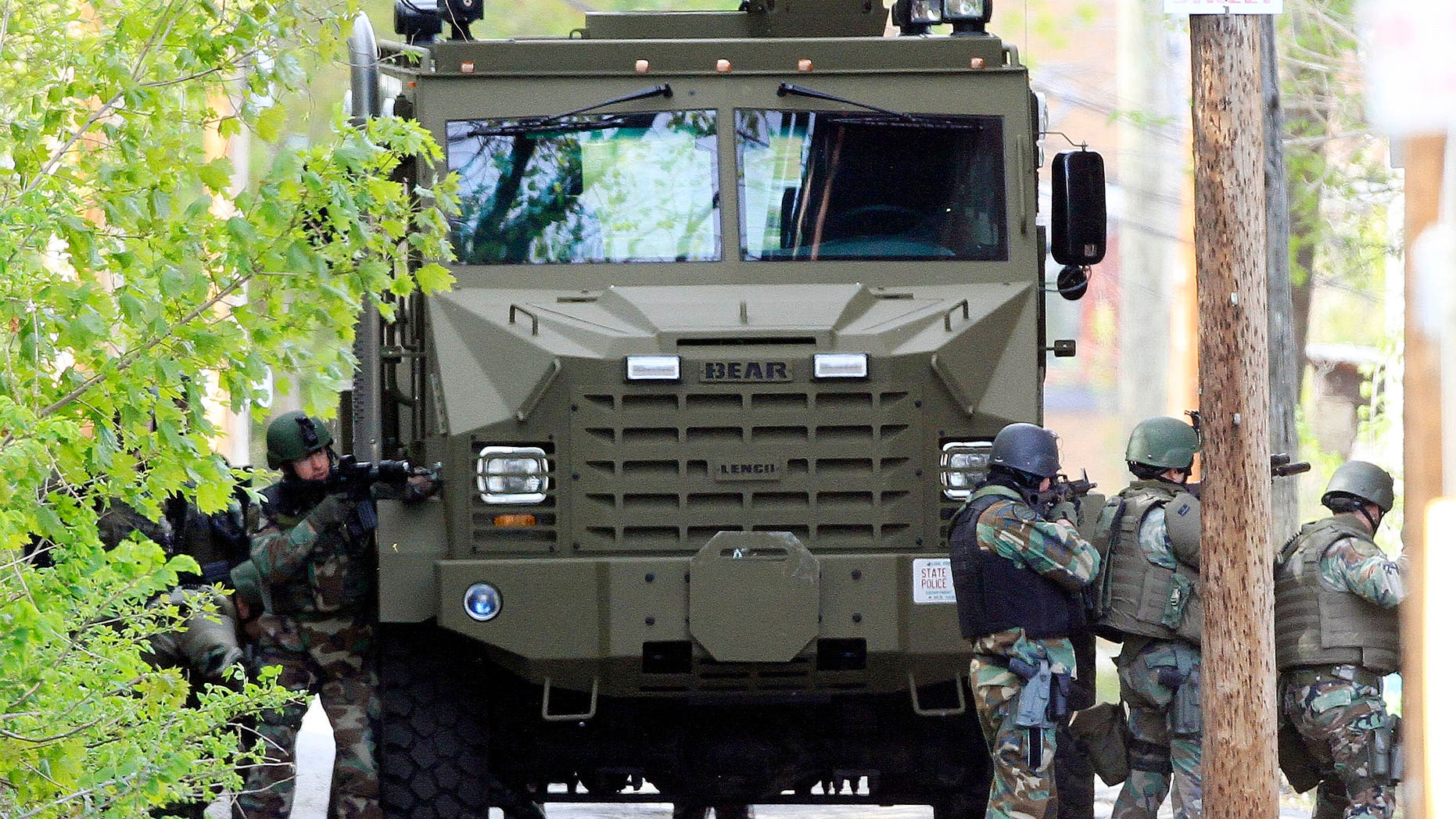 May 6: The state police SWAT team had guns drawn during a police standoff with an armed man in Manchester, N.H. (AP)