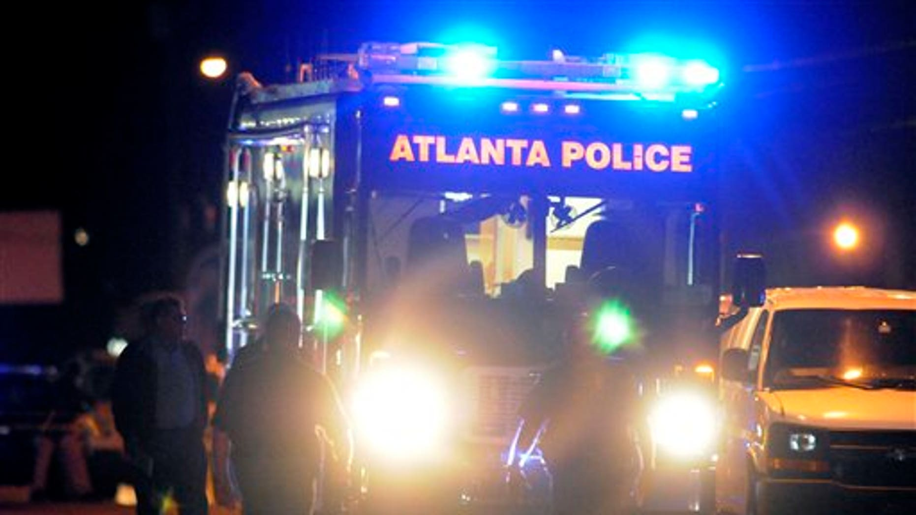 Nov. 4, 2012: Law enforcement personnel investigate the scene of an Atlanta Police Department helicopter crash.