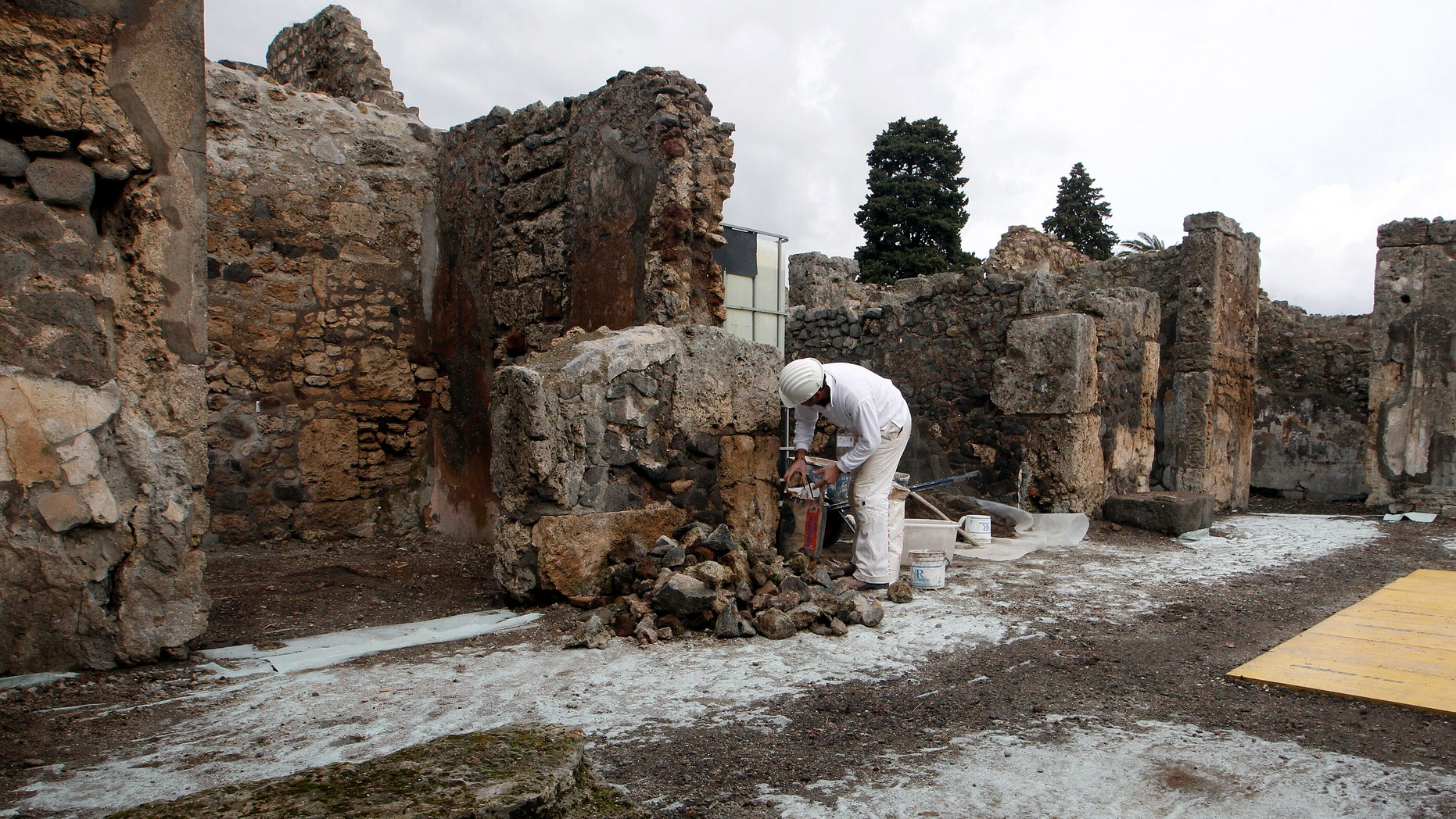 Feb. 6, 2013: A restorer works in the ancient Roman city Pompeii, which was buried in AD 79 by an eruption of the Vesuvius volcano.