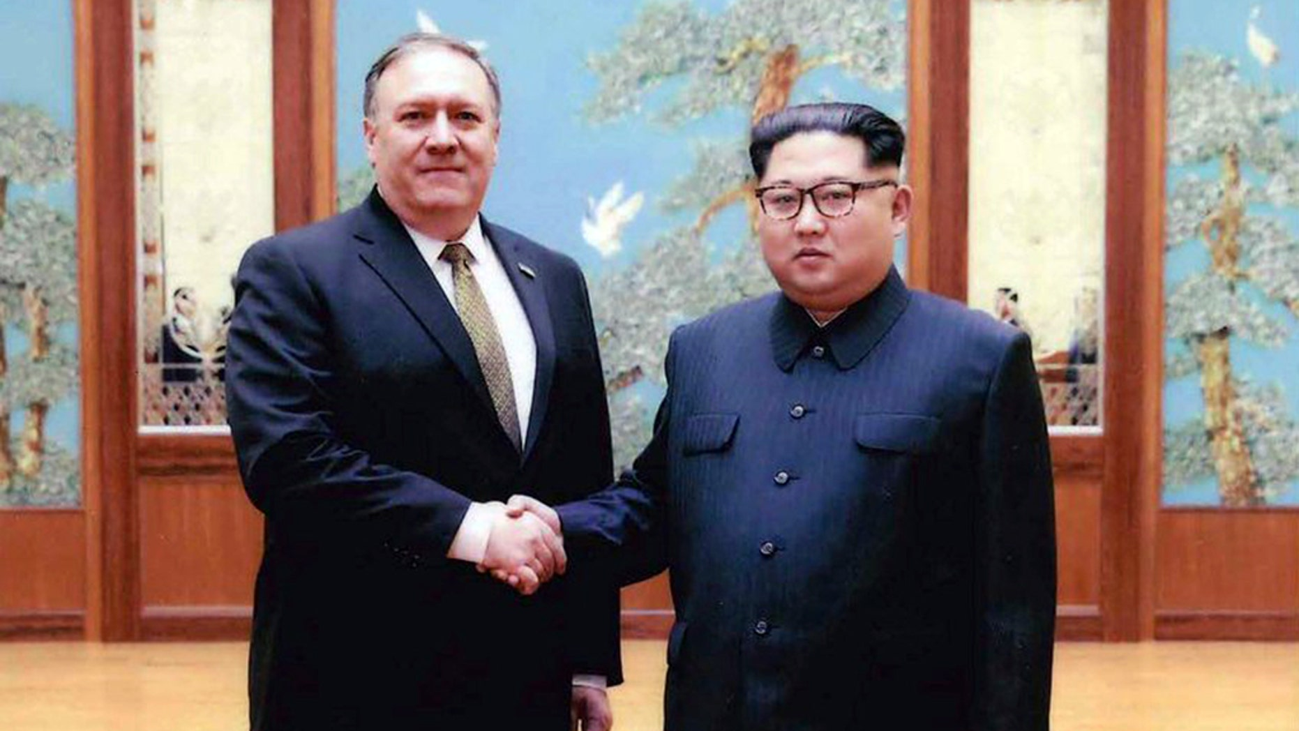New photos were released Thursday of the Easter weekend meeting between then-CIA Director Mike Pompeo and North Korean leader Kim Jong Un.