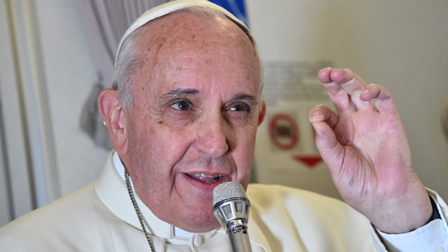 Jan. 19, 2015: Pope Francis gestures as he talks with journalists during his flight from Manila to Rome. (AP Photo/Giuseppe Cacace, pool)