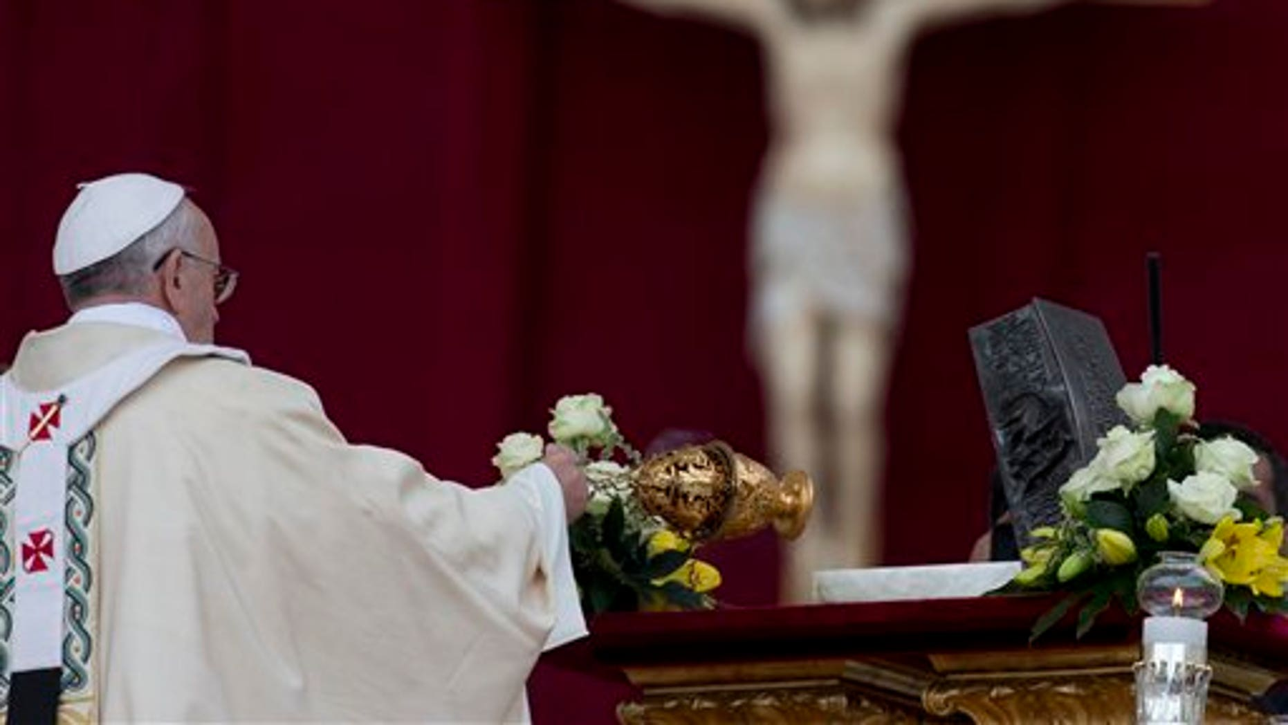Pope Francis blesses the relics of St. Peter as he celebrates mass for the end of the Year of Faith, in St. Peter's Square at the Vatican, Sunday, Nov. 24, 2013. (AP Photo/Andrew Medichini)