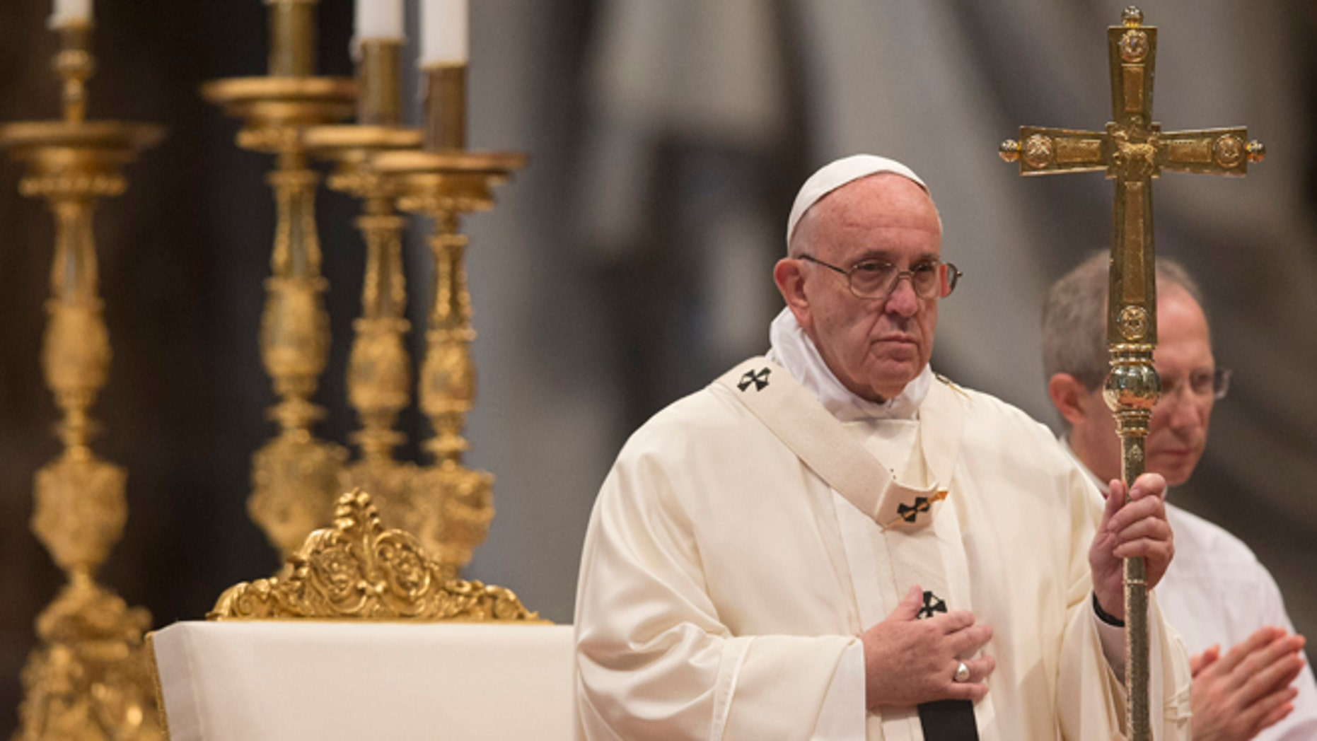 Pope Francis holds the pastoral staff as he celebrates a Mass for families in St.Peter's Basilica at the Vatican, Sunday, Dec. 27, 2015. (AP Photo/Alessandra Tarantino)