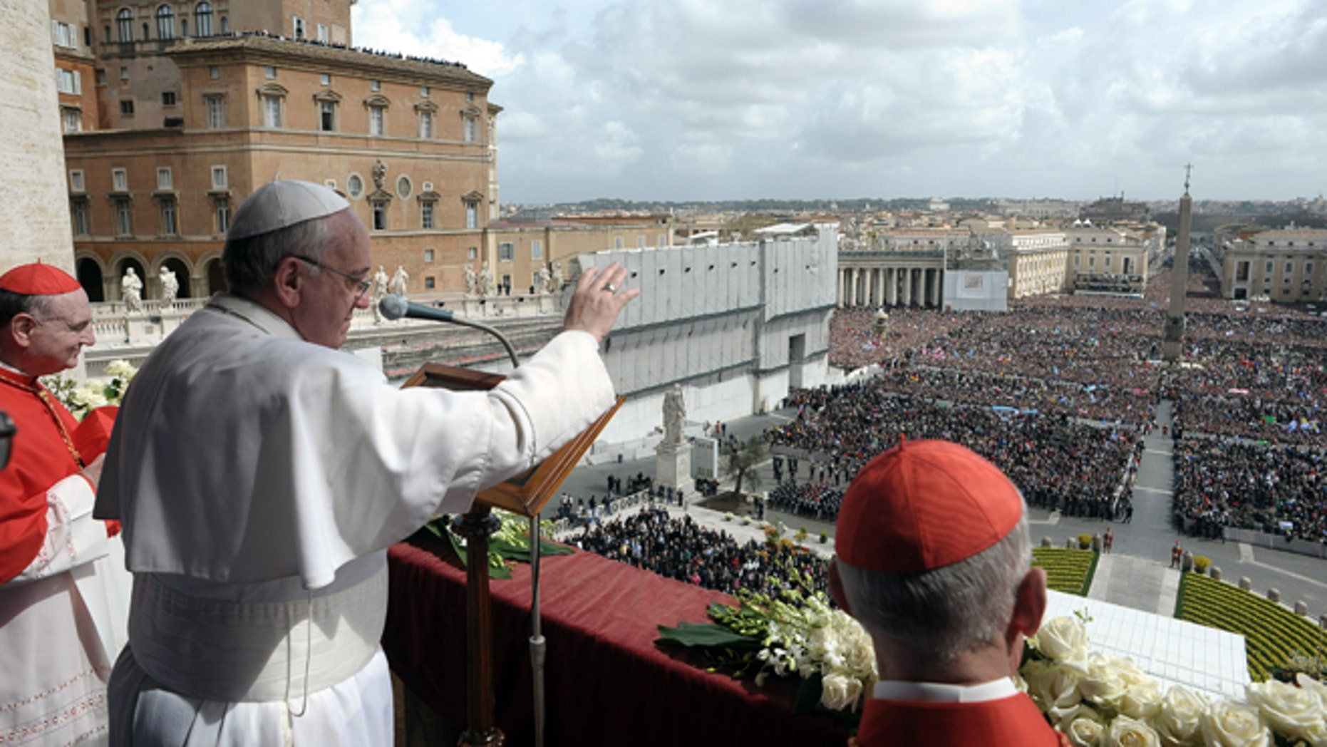 In this photo provided by the Vatican newspaper L'Osservatore Romano, Pope Francis delivers the Urbi et Orbi (to the city and to the world) blessing, in St. Peter's Square at the Vatican, Sunday, March 31, 2013. Pope Francis celebrated his first Easter Sunday Mass as pontiff in St. Peter's Square, packed by joyous pilgrims, tourists and Romans and bedecked by spring flowers.Wearing cream-colored vestments, Francis strode onto the esplanade in front of St. Peter's Basilica and took his place at an altar set up under a white canopy. (AP Photo/L'Osservatore Romano)