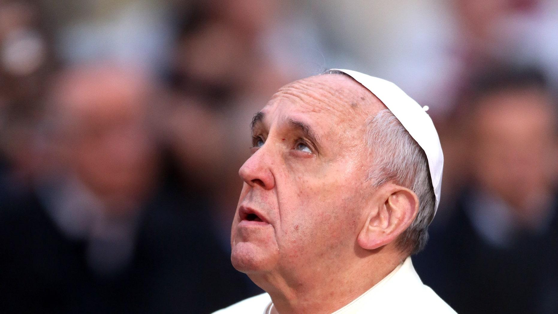 File photo: Pope Francis prays.