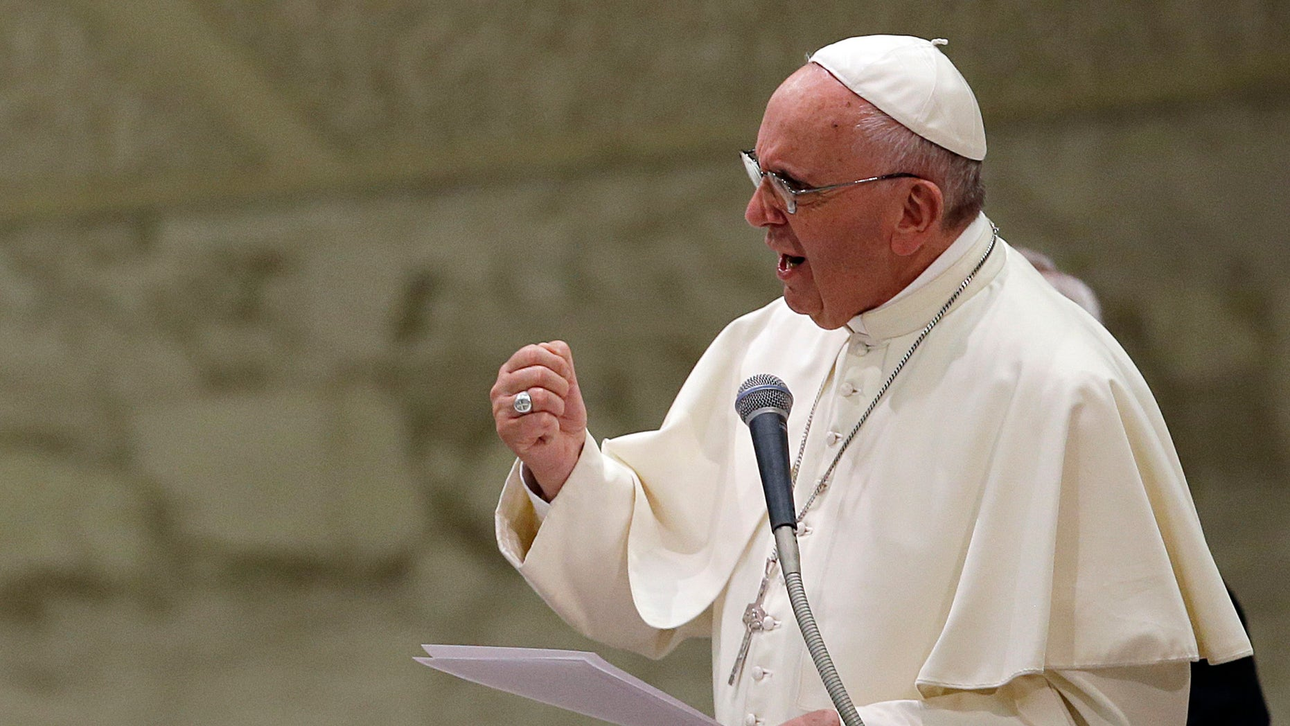 Pope Francis delivers his message during an audience with faithful and employees of the Rome's Cooperative Credit Bank in the Paul VI hall at the Vatican, Saturday, Sept. 12, 2015. To some Republican presidential candidates, itâs better to be with the popular pope than against him. (AP Photo/Gregorio Borgia)