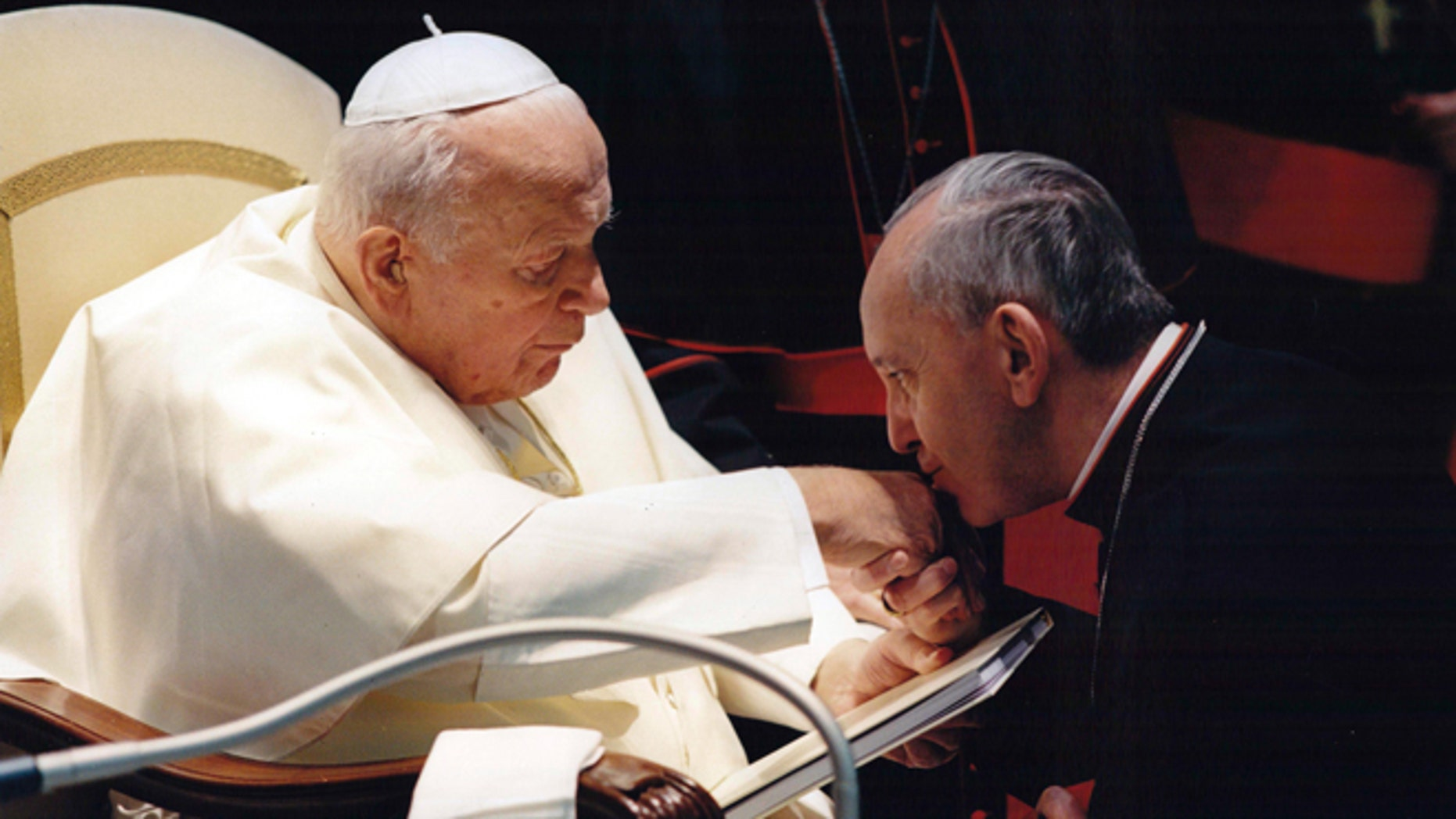 In this undated file photo, Archbishop of Buenos Aires Jorge Mario Bergoglio, now Pope Francis, kisses the hand of Pope John Paul II during a ceremony at the Vatican.