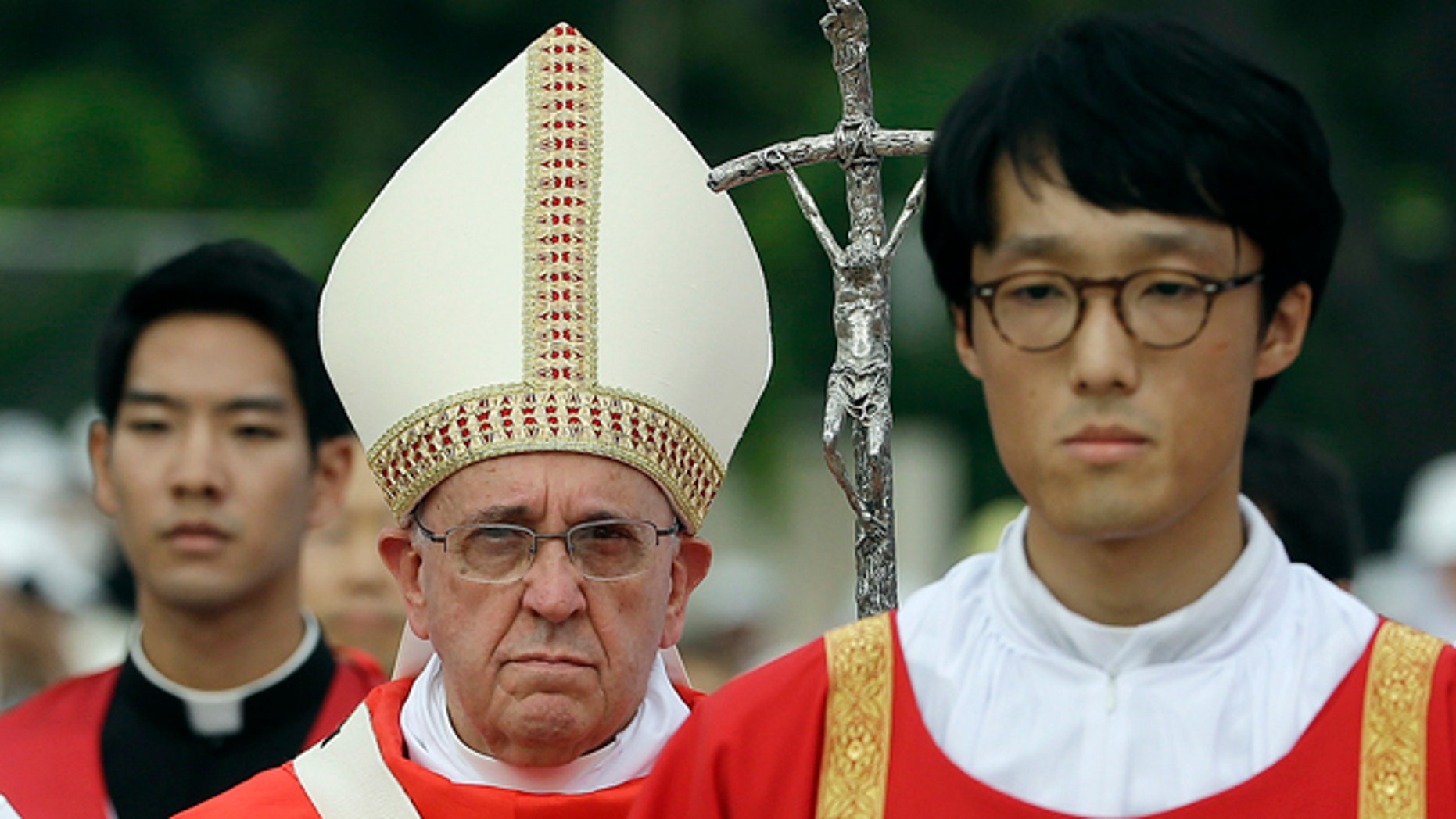 Pope Francis celebrates a mass and the beatification of Paul Yun ji-Chung and 123 martyr companions at Gwanghwamun Gate in Seoul, South Korea, Saturday, Aug. 16, 2014. Paul Yun Ji-Chung was born in 1759 and was among the earliest Catholics on the Korean peninsula. (AP Photo/Gregorio Borgia)