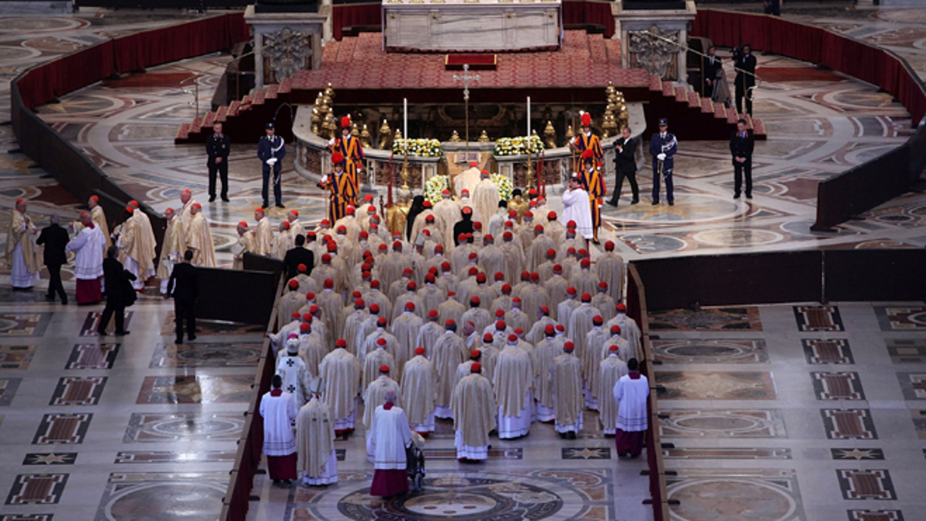 VATICAN CITY, VATICAN - MAY 01:  Pope Benedict XVI and cardinals pray in front of the coffin of John Paul II at St. Peter's Basilica at the end of John Paul II Beatification Ceremony held by Pope Benedict XVI on May 1, 2011 in Vatican City, Vatican. The ceremony marking the beatification and the last stages of the process to elevate Pope John Paul II to sainthood was led by his successor Pope Benedict XI and attended by tens of thousands of pilgrims alongside heads of state and dignitaries.  (Photo by Franco Origlia/Getty Images)