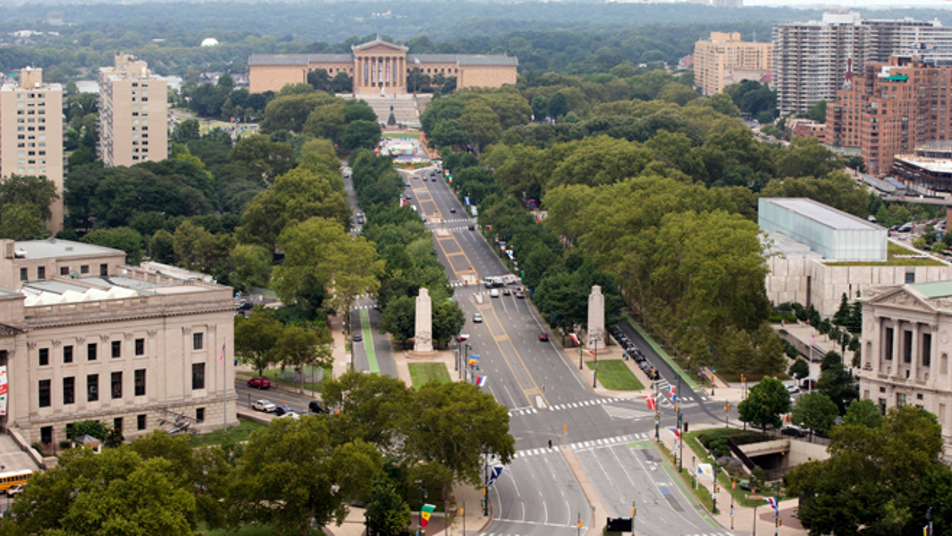 Viewed from the Embassy Suites hotel traffic moves along the Benjamin Franklin Parkway leading to the Philadelphia Museum of Art, Thursday, July 30, 2015, in Philadelphia. On the parkway Pope Francis is scheduled to visit The World Meeting of Families' festival and celebrate a Mass during his visit to the United States. (AP Photo/Matt Rourke)