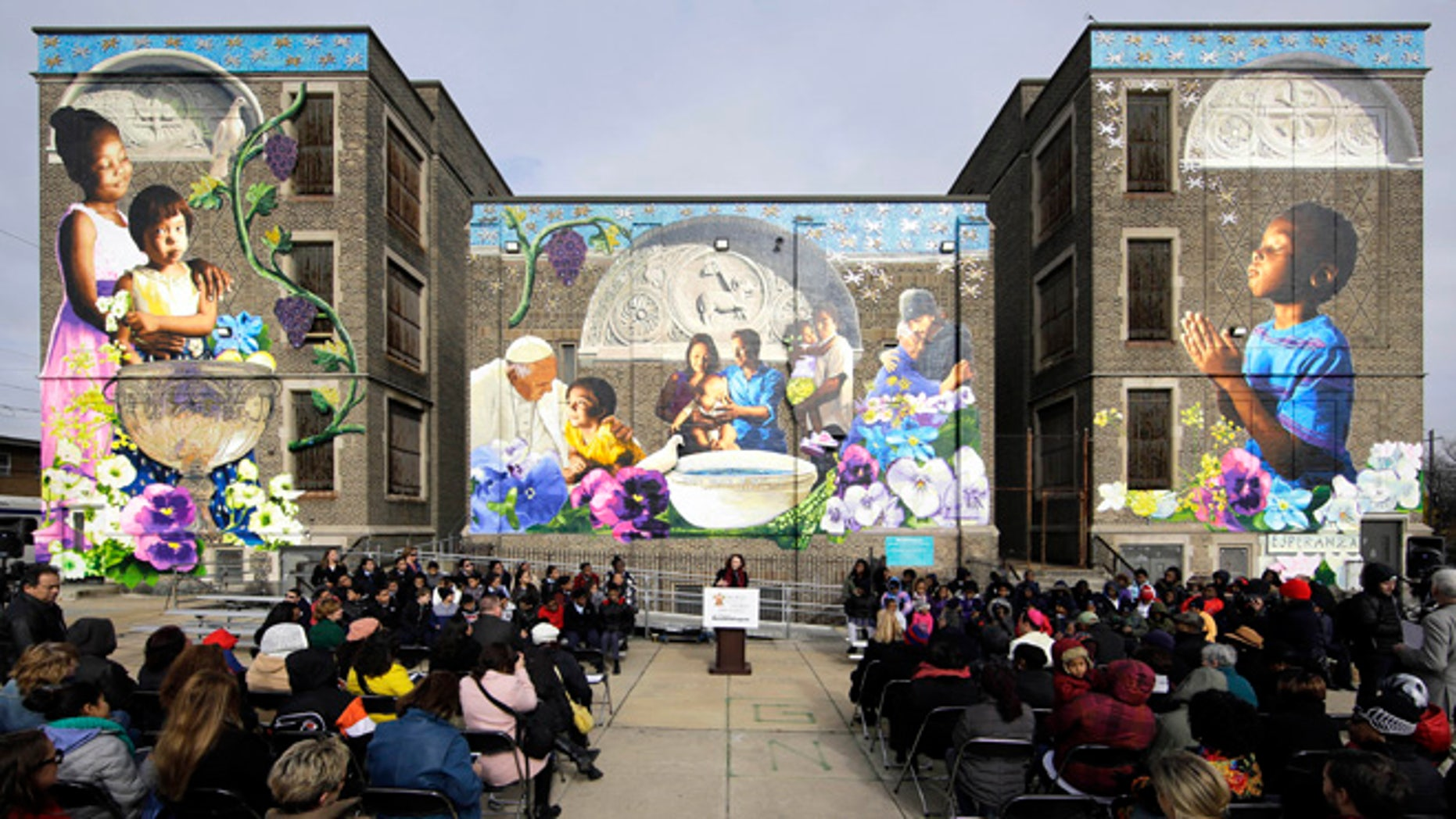 Jane Golden, executive director of the City of Philadelphia Mural Arts Program, speaks during a ceremony dedicating the mural, titled The Sacred Now: Faith and Family in the 21st Century, Monday, Nov. 30, 2015, in Philadelphia. Organizers are hoping the mural featuring Pope Francis is eligible for the Guinness World Record for âMost Contributions to a Painting by Numbers.â More than 2,700 people, including the pontiff himself, helped create the multistory artwork.  (AP Photo/Matt Rourke)