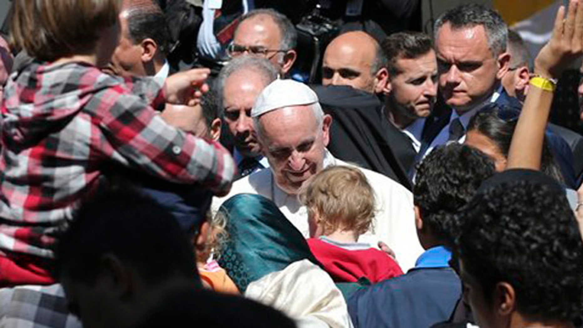 Pope Francis meets migrants at the Moria refugee camp on the Greek island of Lesbos,  Saturday April 16, 2016. Pope Francis travelled Saturday to Greece for a brief but provocative visit to meet with refugees at a detention center as the European Union implements a controversial plan to deport them back to Turkey. (AP Photo/Petros Giannakouris)
