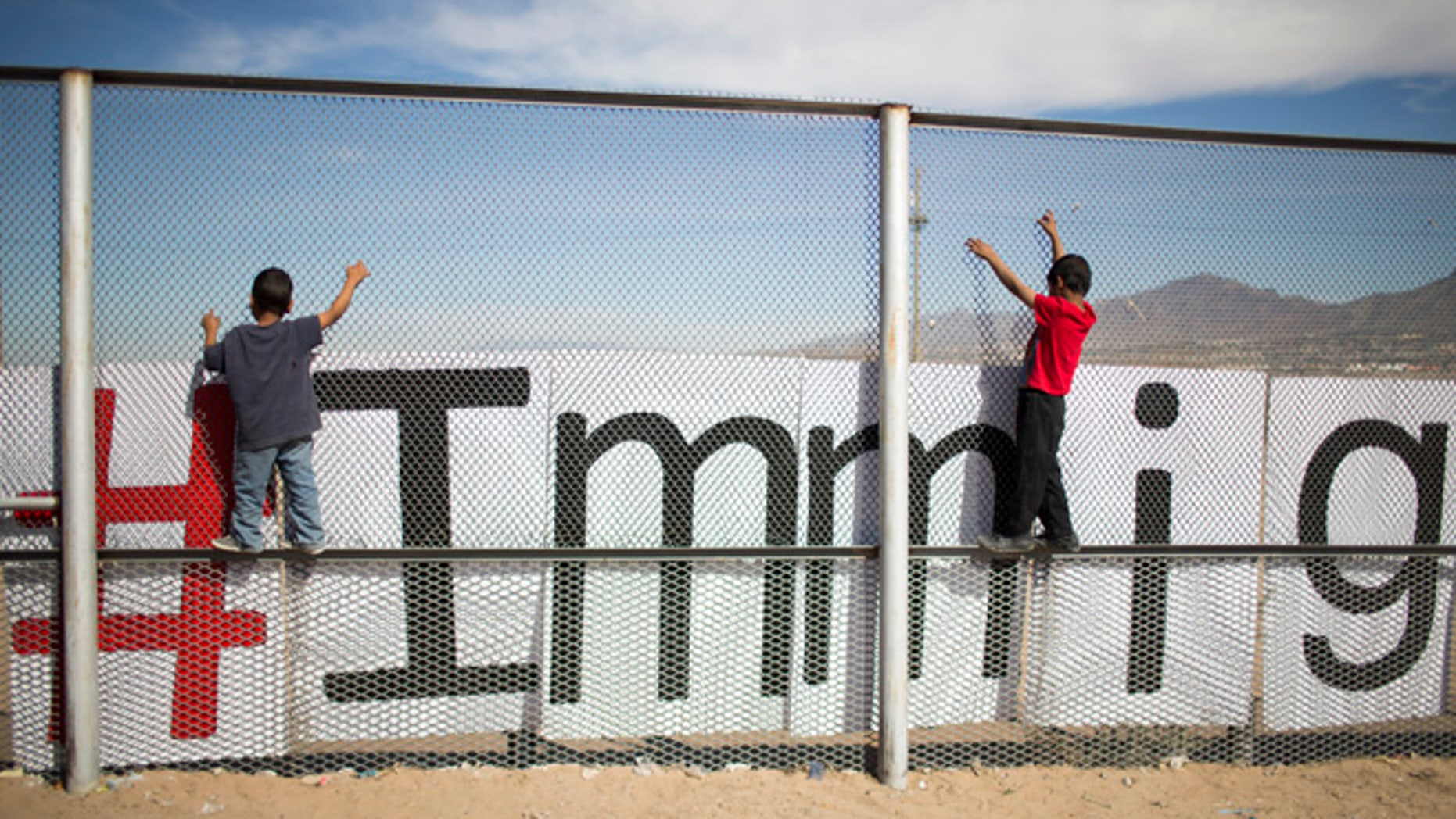 "Two small boys balance themselves on the rail of a border fence during an event organized by the Border Network for Human Rights, on the outskirts of  Ciudad Juarez, Mexico, Monday, Feb. 15, 2016. Pope Francis will conclude his weeklong Mexico trip with a visit to Ciudad Juarez where he will meet with Mexican workers, grassroots groups and employers in an encounter where he'll likely repeat his mantra on the need for dignified work for all and ""land, labor and lodging."" (AP Photo/Ivan Pierre Aguirre)"