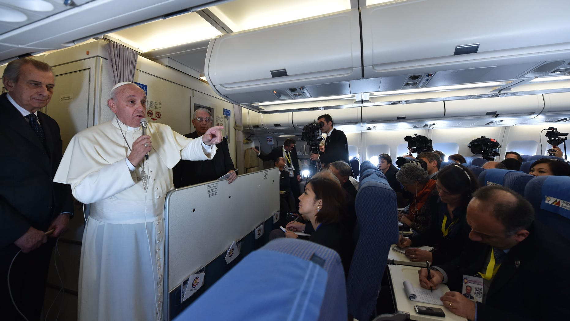 Jan. 19, 2015 - Pope Francis talks with journalists during his flight from Manila to Rome. Although the trips are unconfirmed, Francis is expected to visit Philadelphia, the White House, and the UN in New York in September.