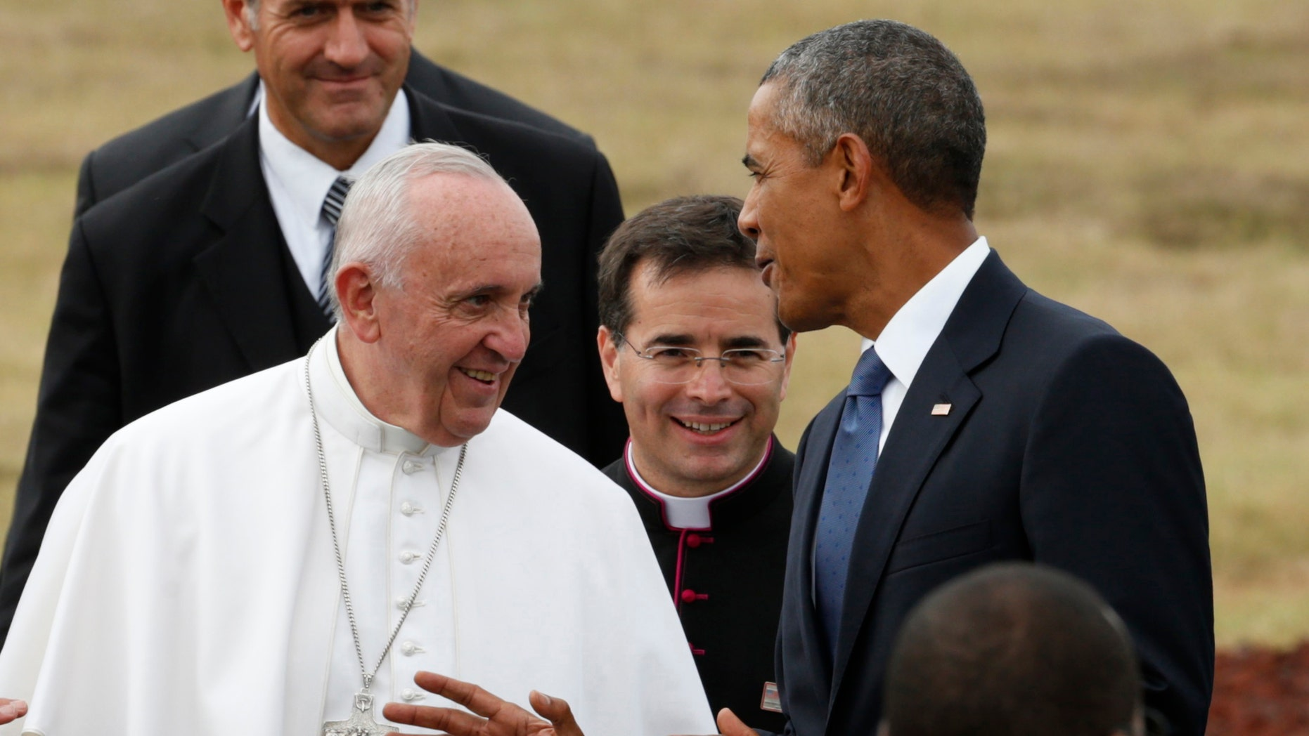 U.S. President Barack Obama chats with Pope Francis as he welcomes him upon his arrival at Joint Base Andrews outside Washington Sept. 22, 2015.