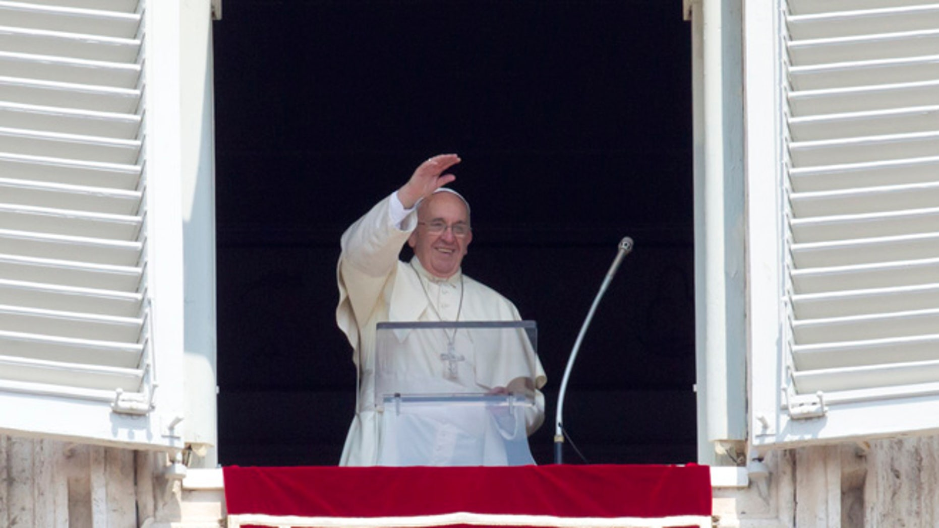 Aug. 9, 2015: Pope Francis waves before reciting the Angelus noon prayer from his window overlooking St. Peter's Square at the Vatican, in Italy.