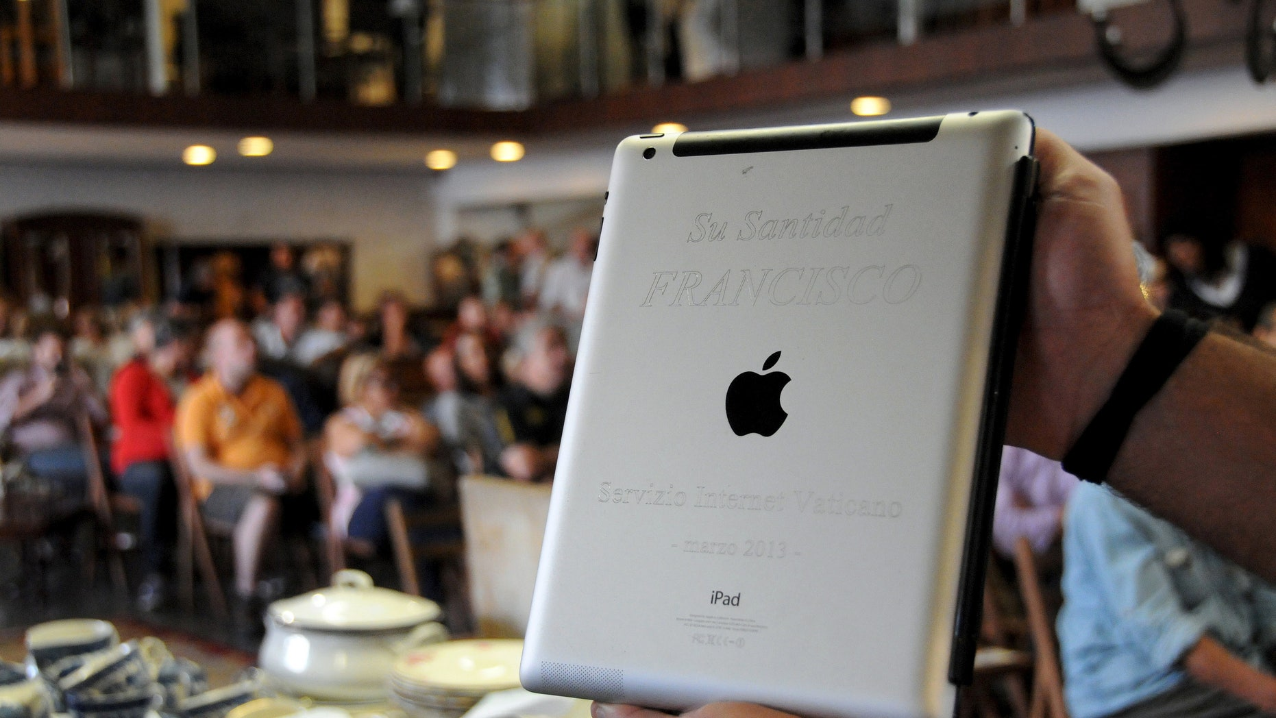 An Apple iPad which belonged to Pope Francis is seen at Castells auction house in Montevideo, April 14, 2015.