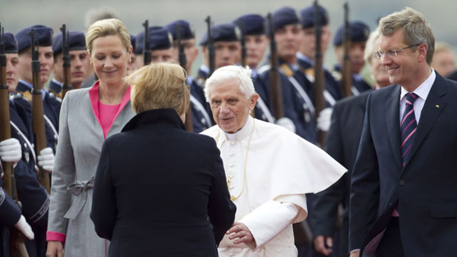 September 22: German Chancellor Angela Merkel, front, welcomes Pope Benedict XVI, center, after his arrival at the Tegel airport in Berlin, Germany.