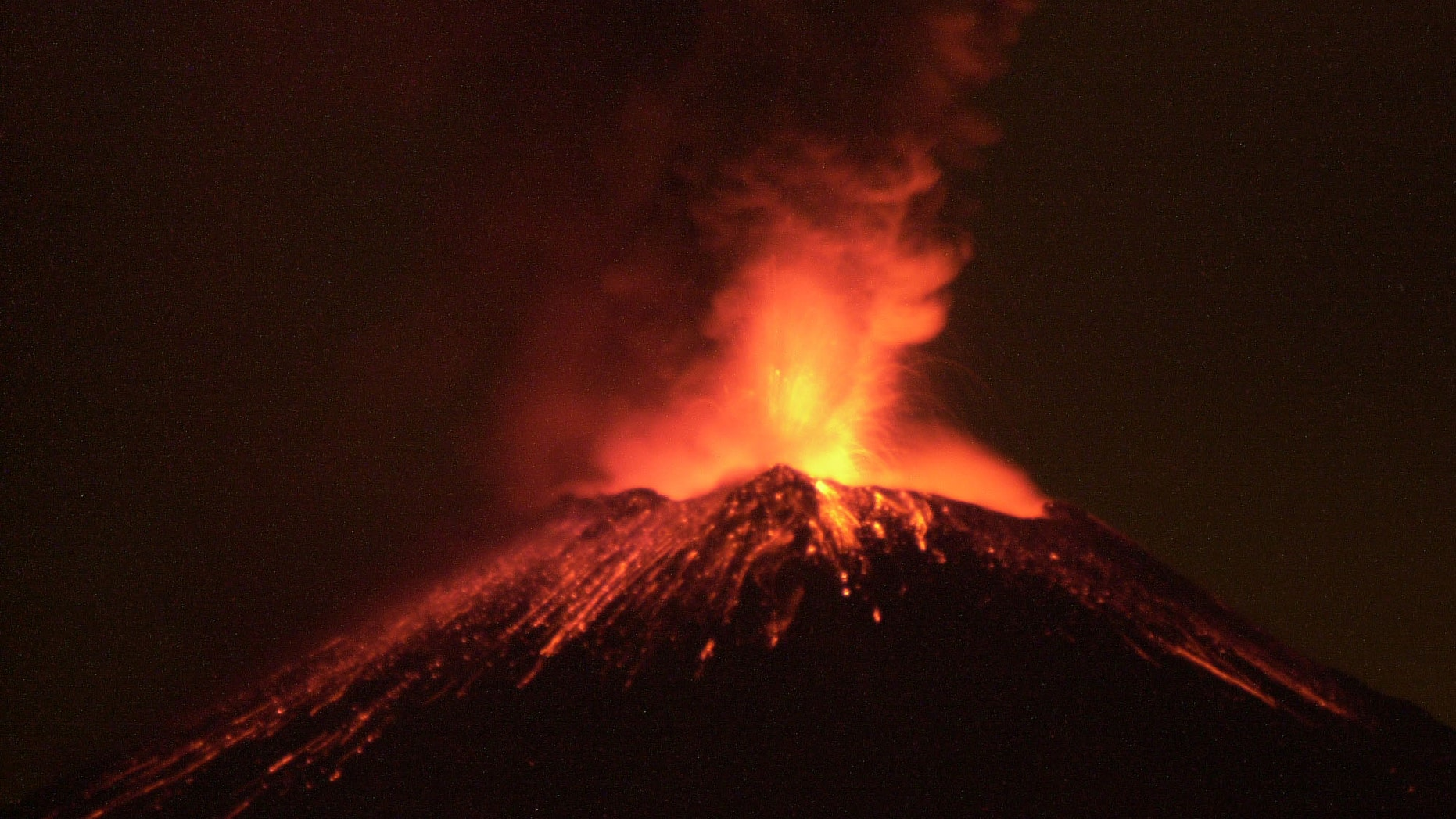 383484 01: The Popocatepetl volcano spews rocks and ash early December 19, 2000 in central Mexico. Centuries after its last catastrophic eruption, the volcano is showing signs of activity and has forced the evacuation of people from villages nearby. (Photo by Susana Gonzalez/Newsmakers)