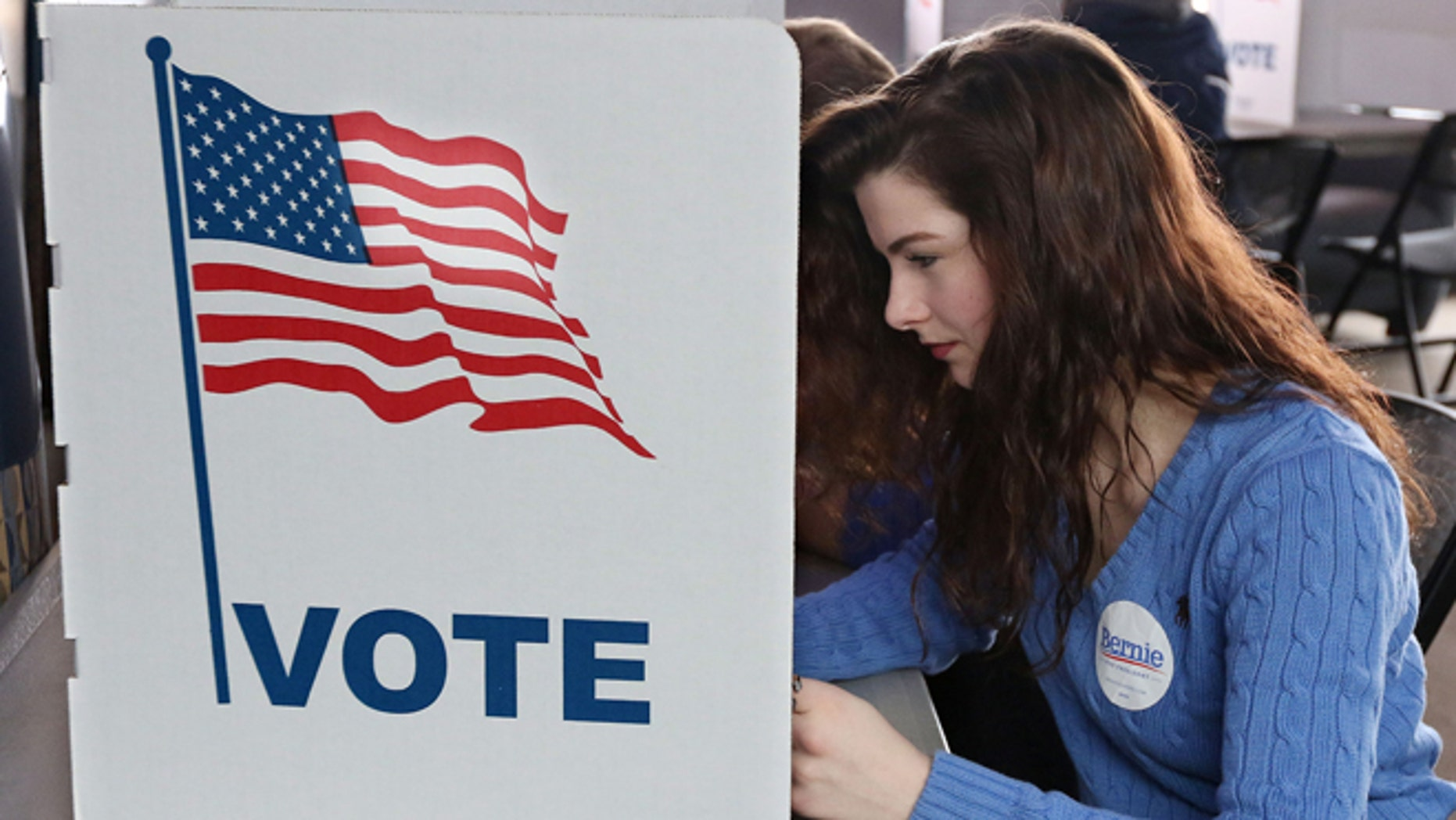 Abi Nesbitt, a UW-Eau Claire freshman from Mosinee, Wis., votes in her first primary election at UW-Eau Claire's Davies Center on Tuesday morning, April 5, 2016. (Dan Reiland/The Eau Claire Leader-Telegram via AP)