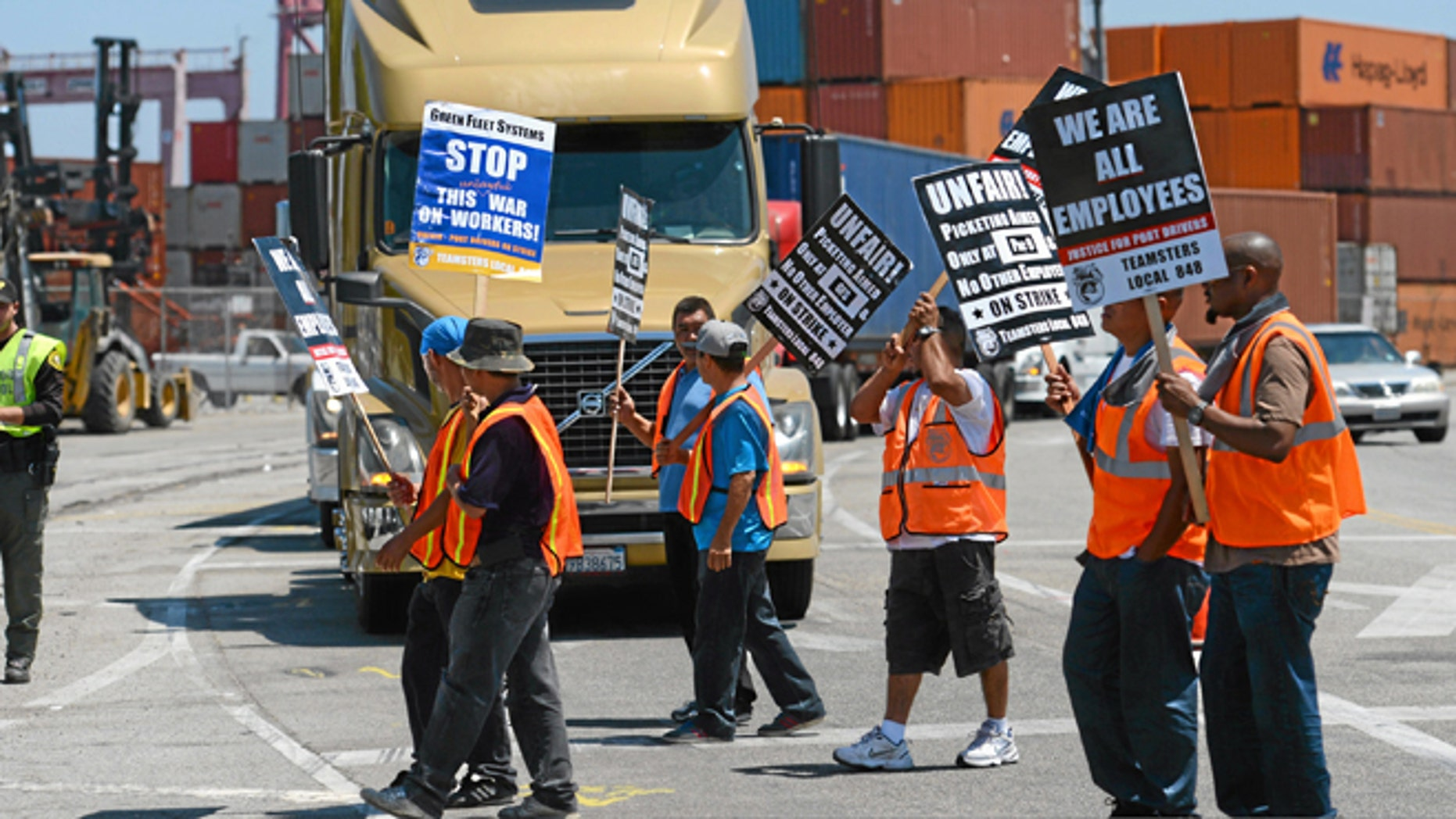 This July 8, 2014 file photo shows members of the Teamsters Union picketing at the Port of Long Beach, Calif.