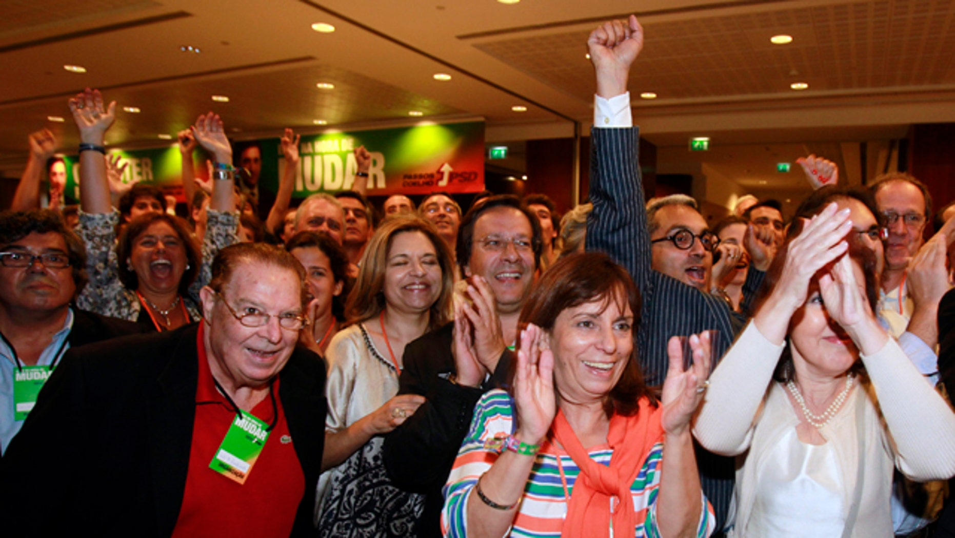 June 5: Supporters of the center-right Social Democratic Party, PSD, react to the exit polls results shown on TV screens seconds after voting closed in Portugal at a hotel in Lisbon. Exit polls showed the PSD unseating the ruling Socialist Party.