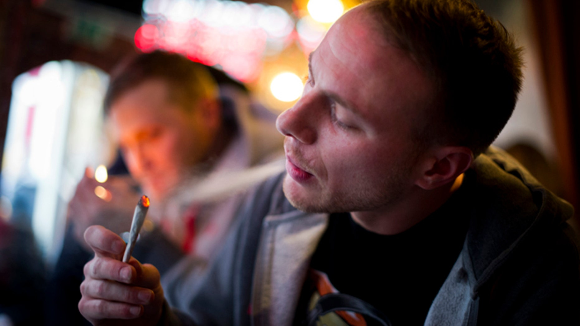 AMSTERDAM, NETHERLANDS - NOVEMBER 01:  Jay, 29 years old from London, smokes cannabis in a coffee shop on November 1, 2012 in the center of Amsterdam, Netherlands. Coffee shops in the Dutch captial will remain open to tourists after its mayor, Eberhard van der Laan, decided that tourists will not be banned from the 220 coffee shops in Amsterdam where marijuana and hashish are openly sold and consumed. The decision came after the new government of the Netherlands stated that it would be up to local authorities to decide whether or not to impose a ban on cannabis.  (Photo by Jasper Juinen/Getty Images)