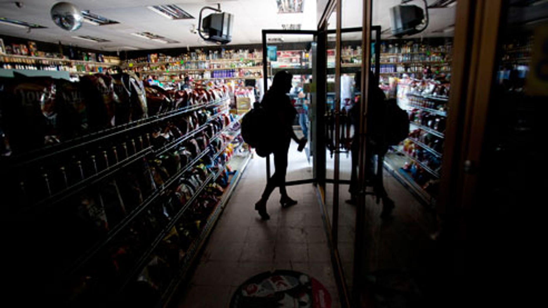 This Sept. 8, 2011 file photo shows Deborah Springs shopping in a convenience store for food items after a power outage in San Diego. There were no catastrophes caused by the widespread outage that knocked out power in a region with a population of nearly 6 million spanning both sides of the U.S.-Mexico border. But for individuals and institutions alike it was a defining moment that separated the Boy Scouts of the world from the rest of us.
